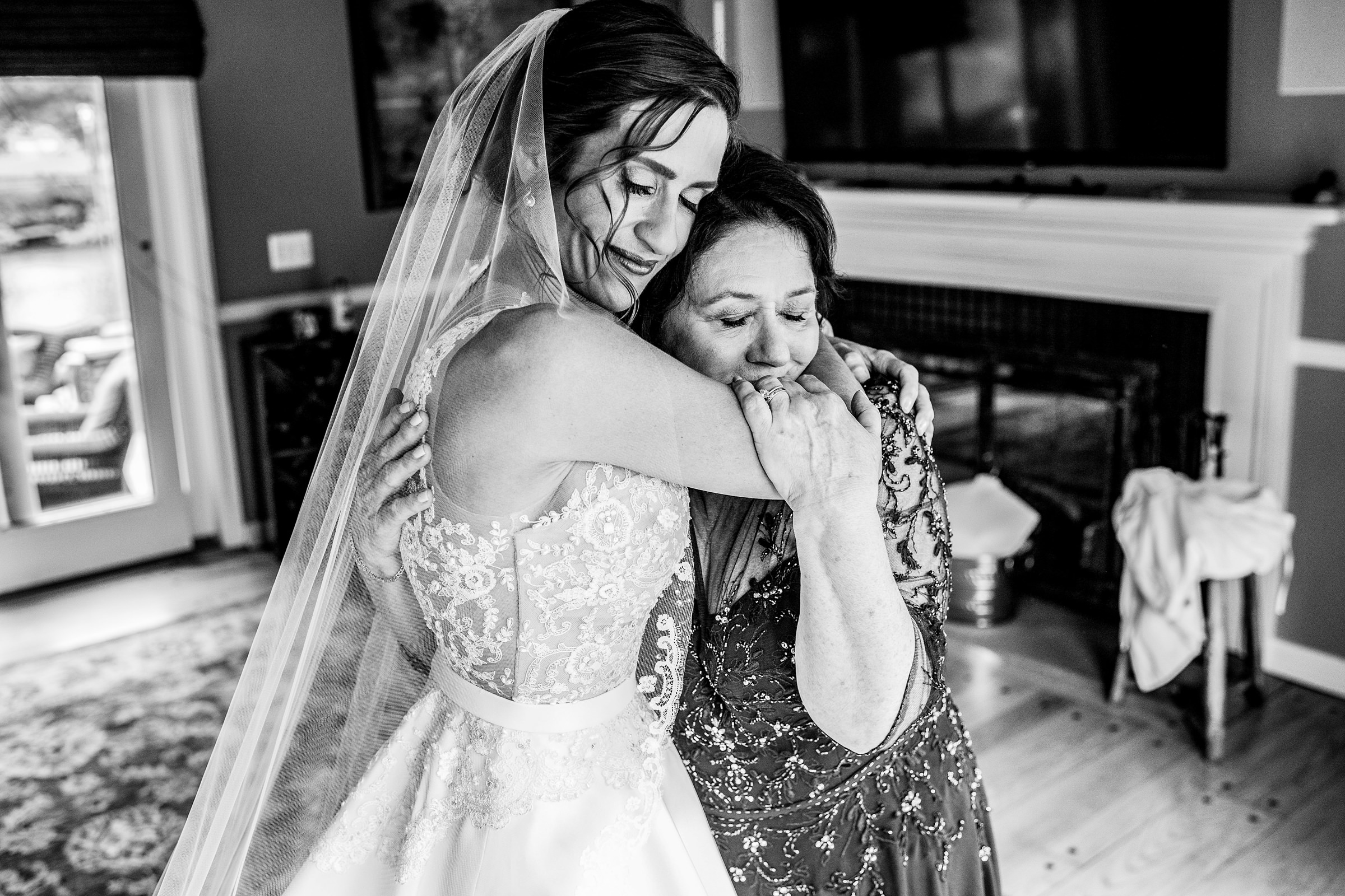 Bride and mother hug in a moment alone  - photo by Jeff Tisman Photography, New York
