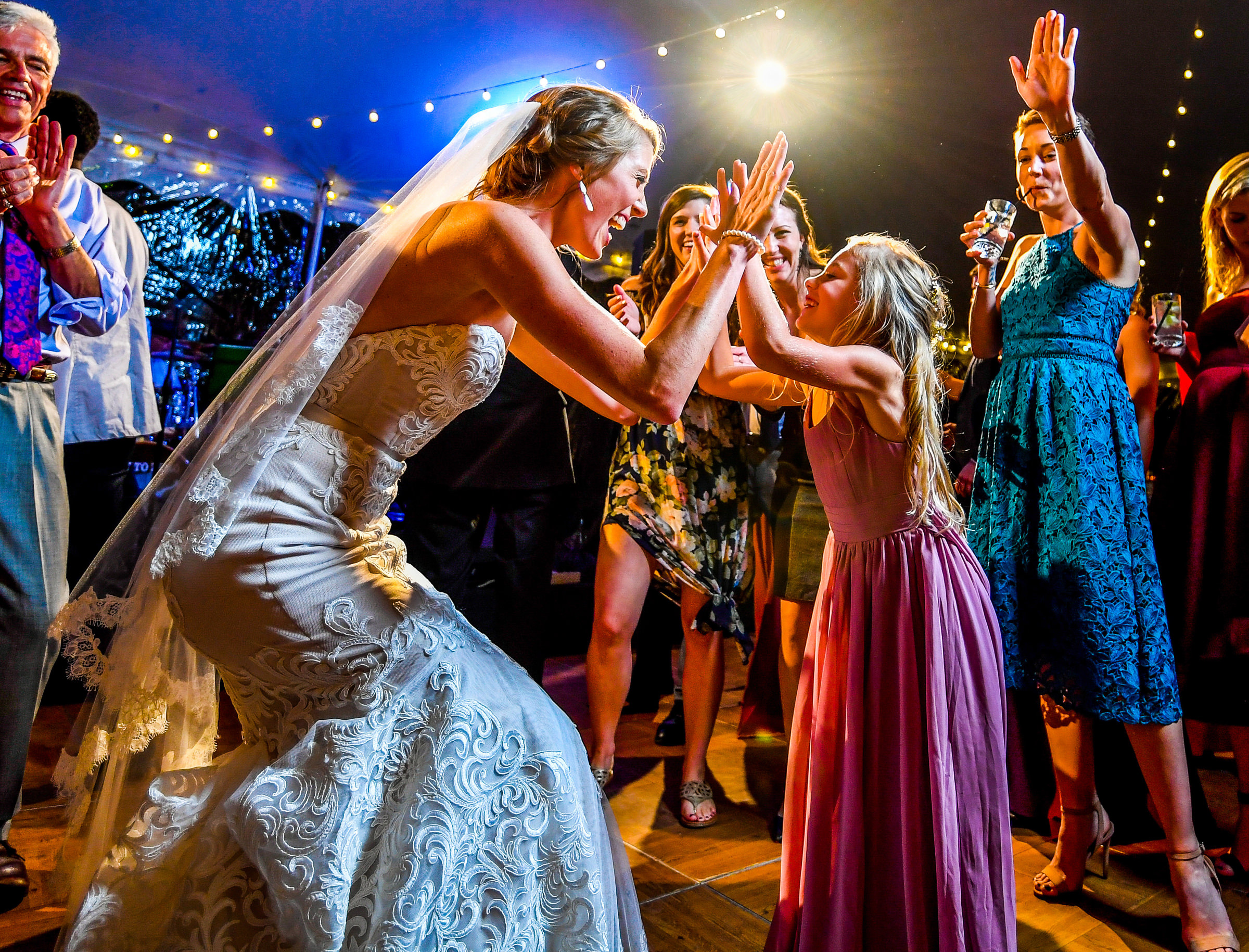 Bride gives a high-five to girl on dance floor - photo by Jeff Tisman Photography, New York