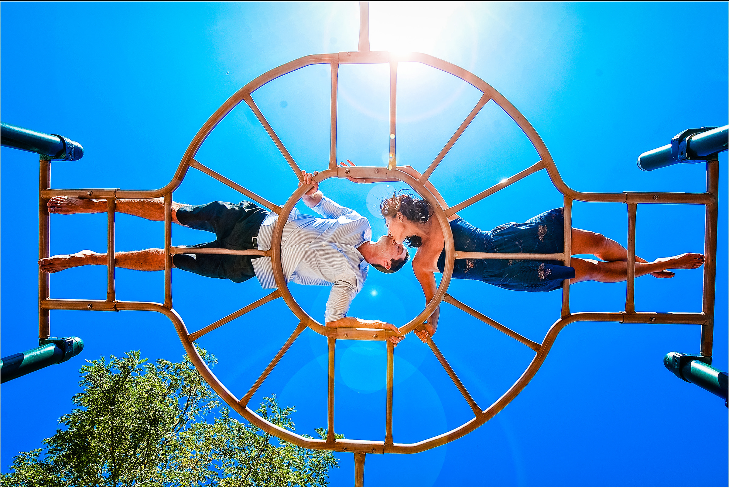 Couple on playground structure - photo by Jeff Tisman Photography