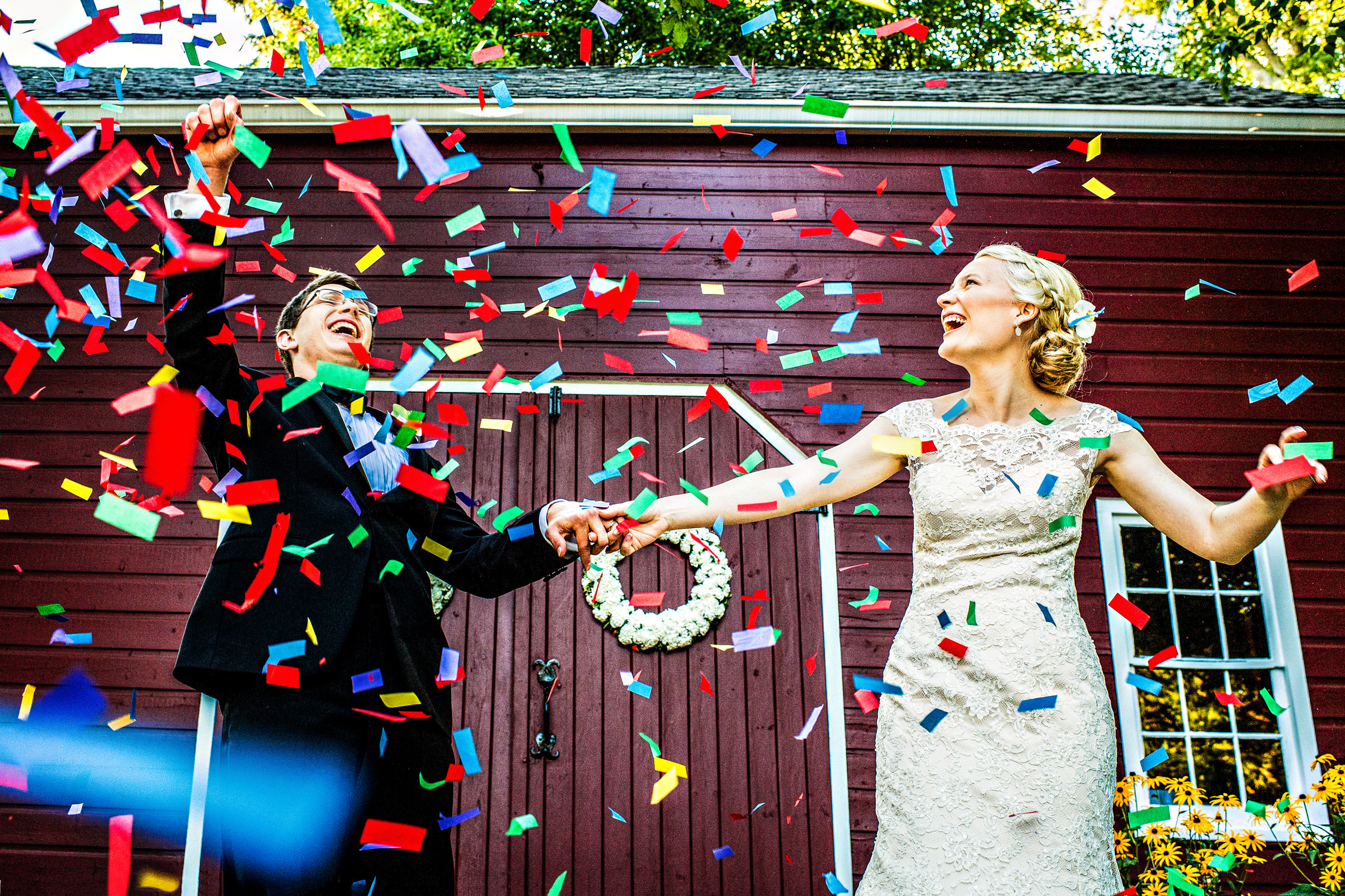 Couple under colorful confetti - photo by Jeff Tisman Photography