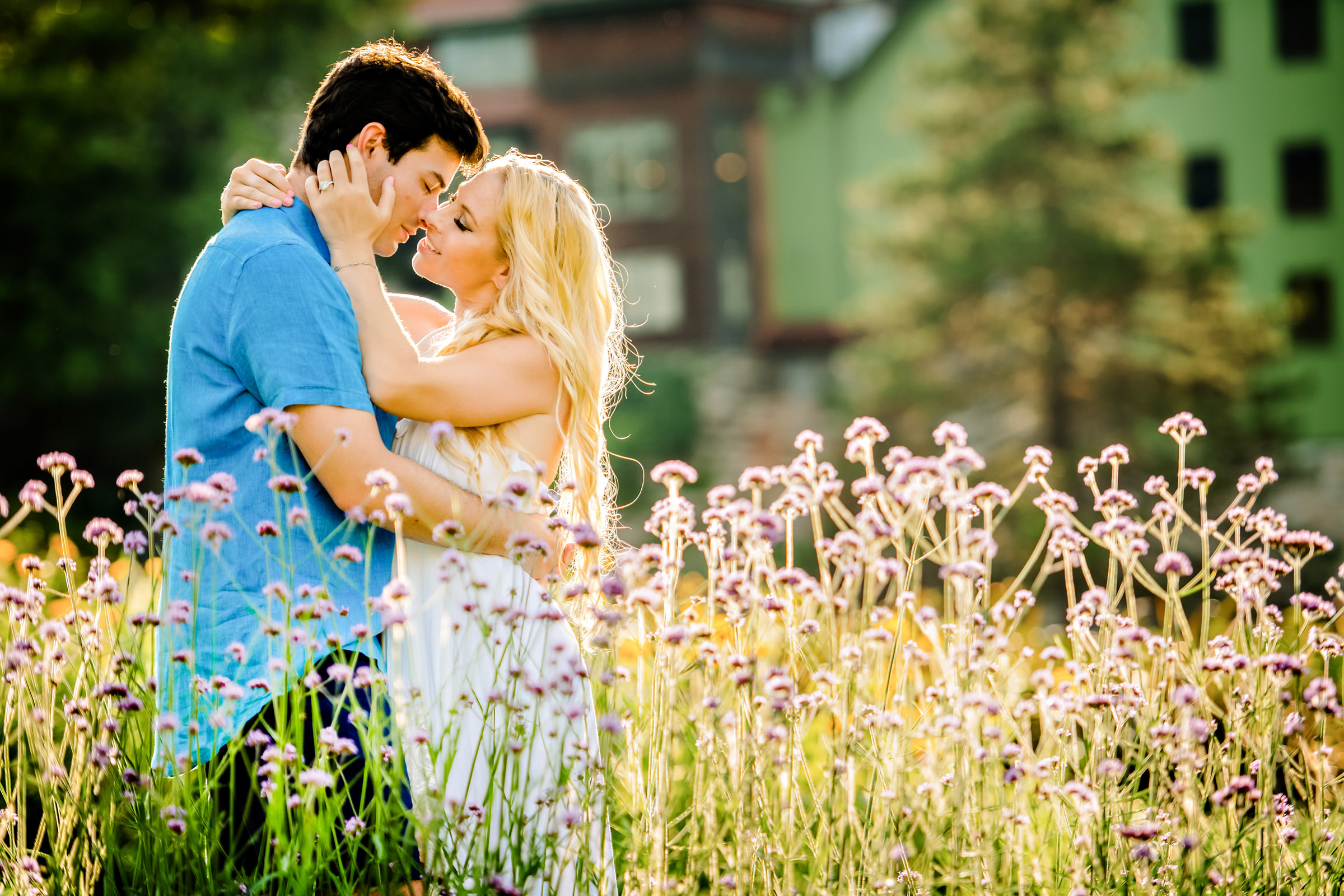 Embracing couple in flowering field - photo by Jeff Tisman Photography