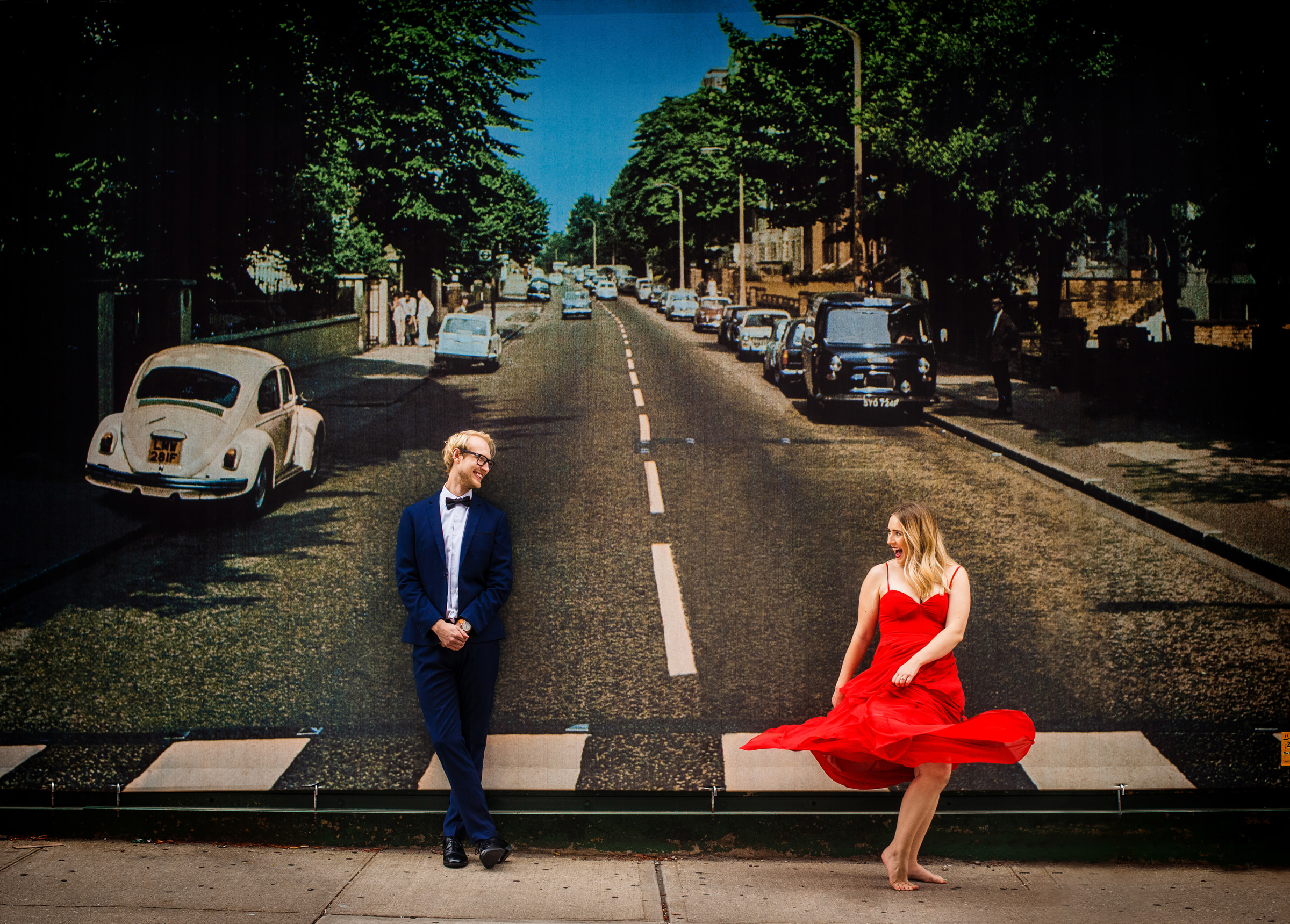 Engagement couple against painting of vintage street - photo by Jeff Tisman Photography