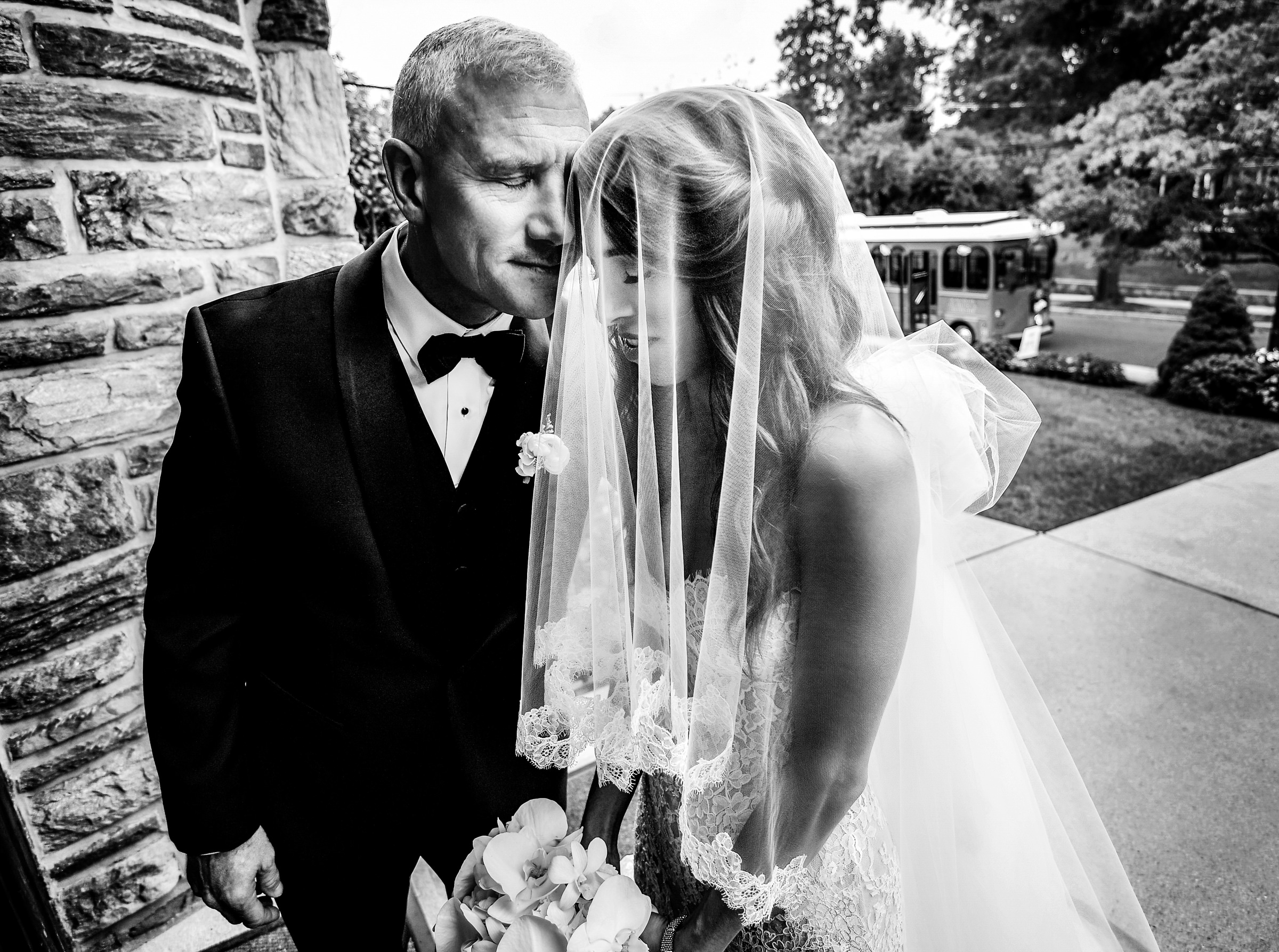 Father lays his head on bride before going in church - photo by Jeff Tisman Photography - New York