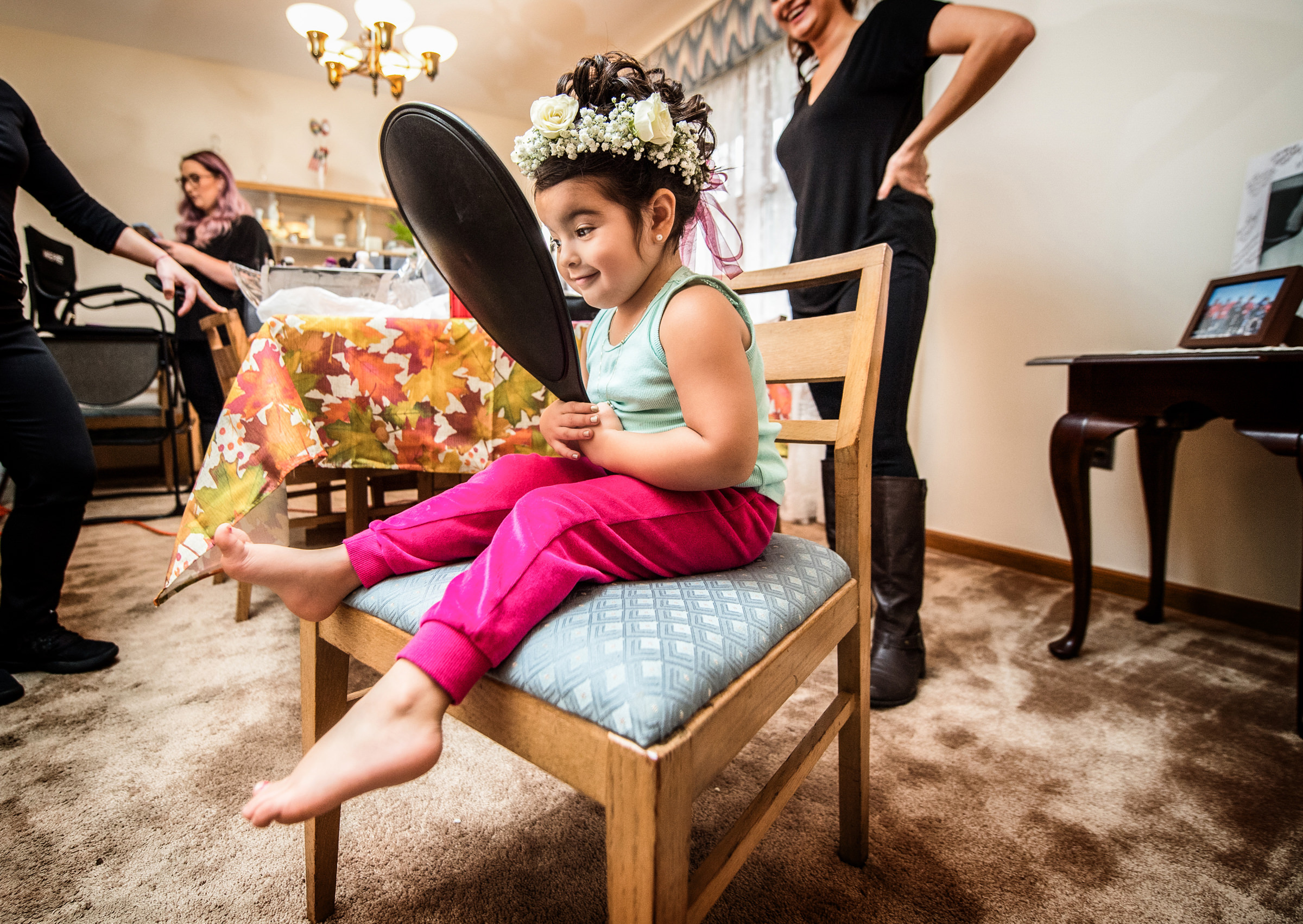 Flower girl admires her crown in the mirror - photo by Jeff Tisman Photography, New York