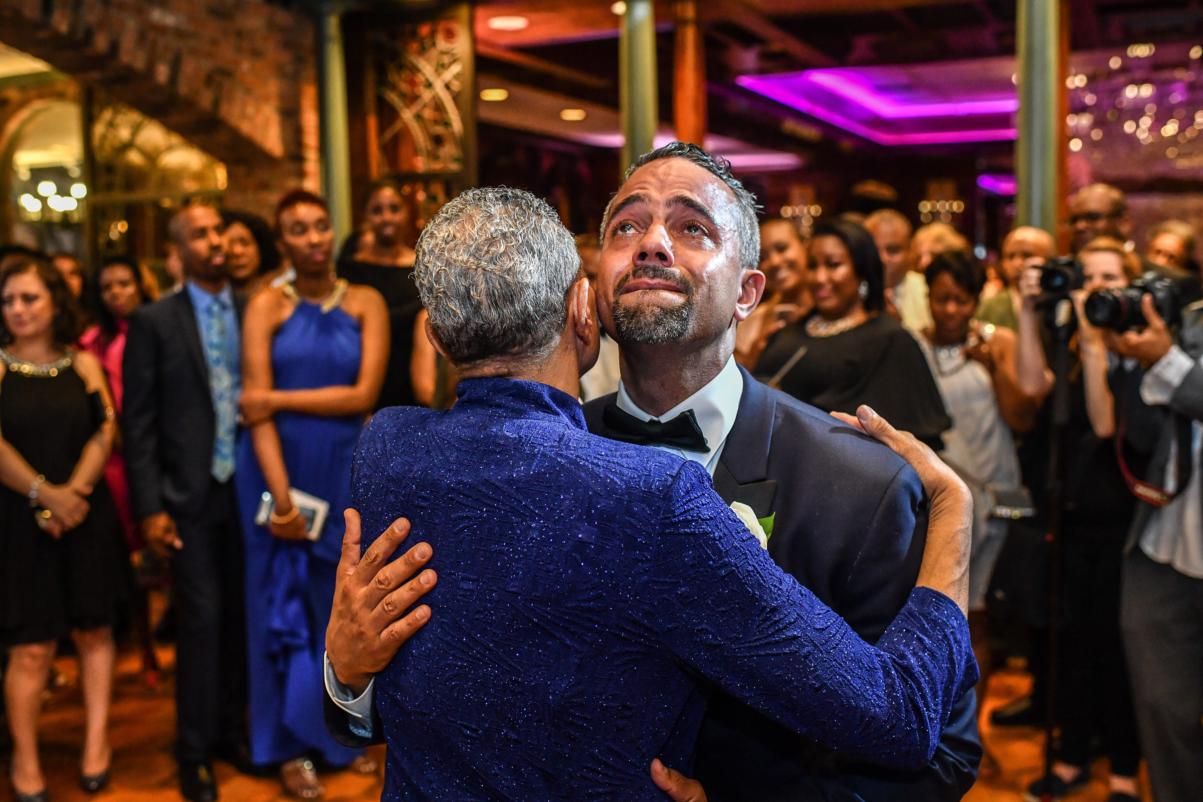 Groom cries while dancing with partner - photo by Jeff Tisman Photography, New York