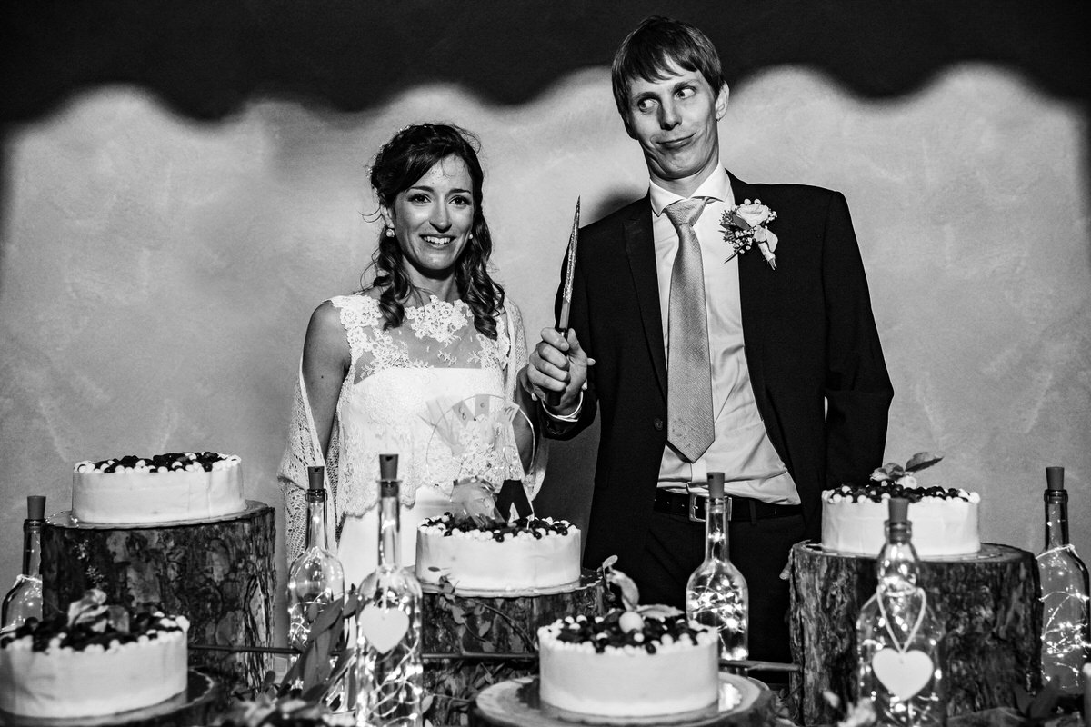 Comical portrait of couple about to slice the cake - photo by Luca+Marta Gallizio