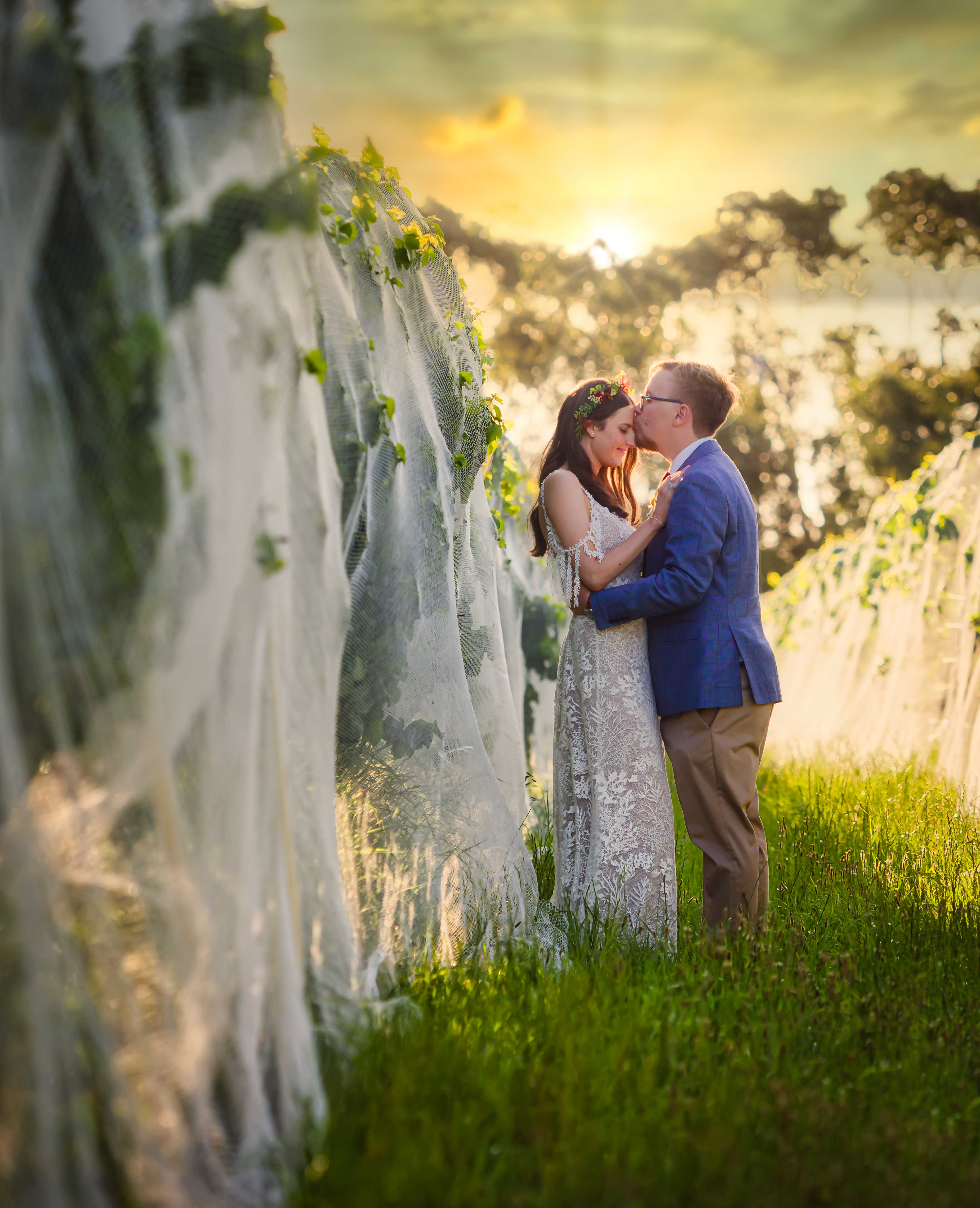 soft focus outdoor kiss - photo by Sean Reefman Photography
