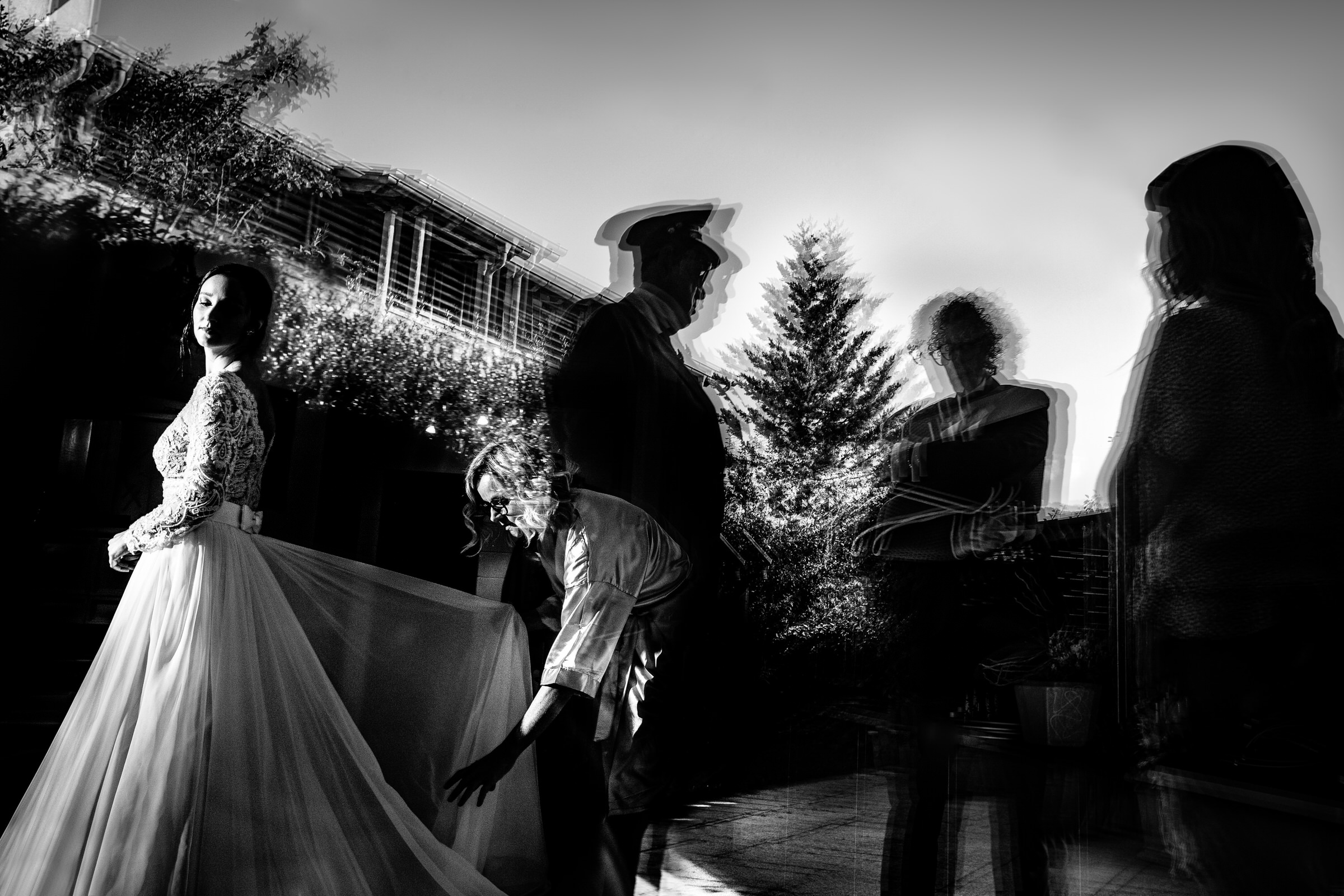 Bride with attendant and blurred others - photo by Luca + Marta Gallizio Photography