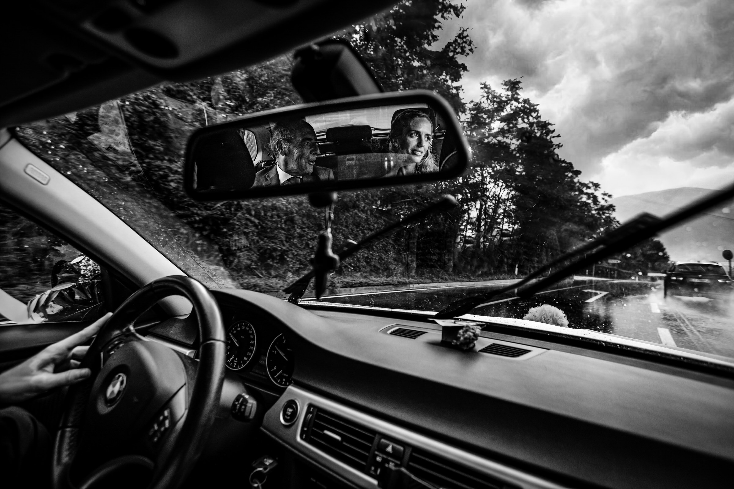 Couple in rear view mirror - photo by Luca + Marta Gallizio Photography