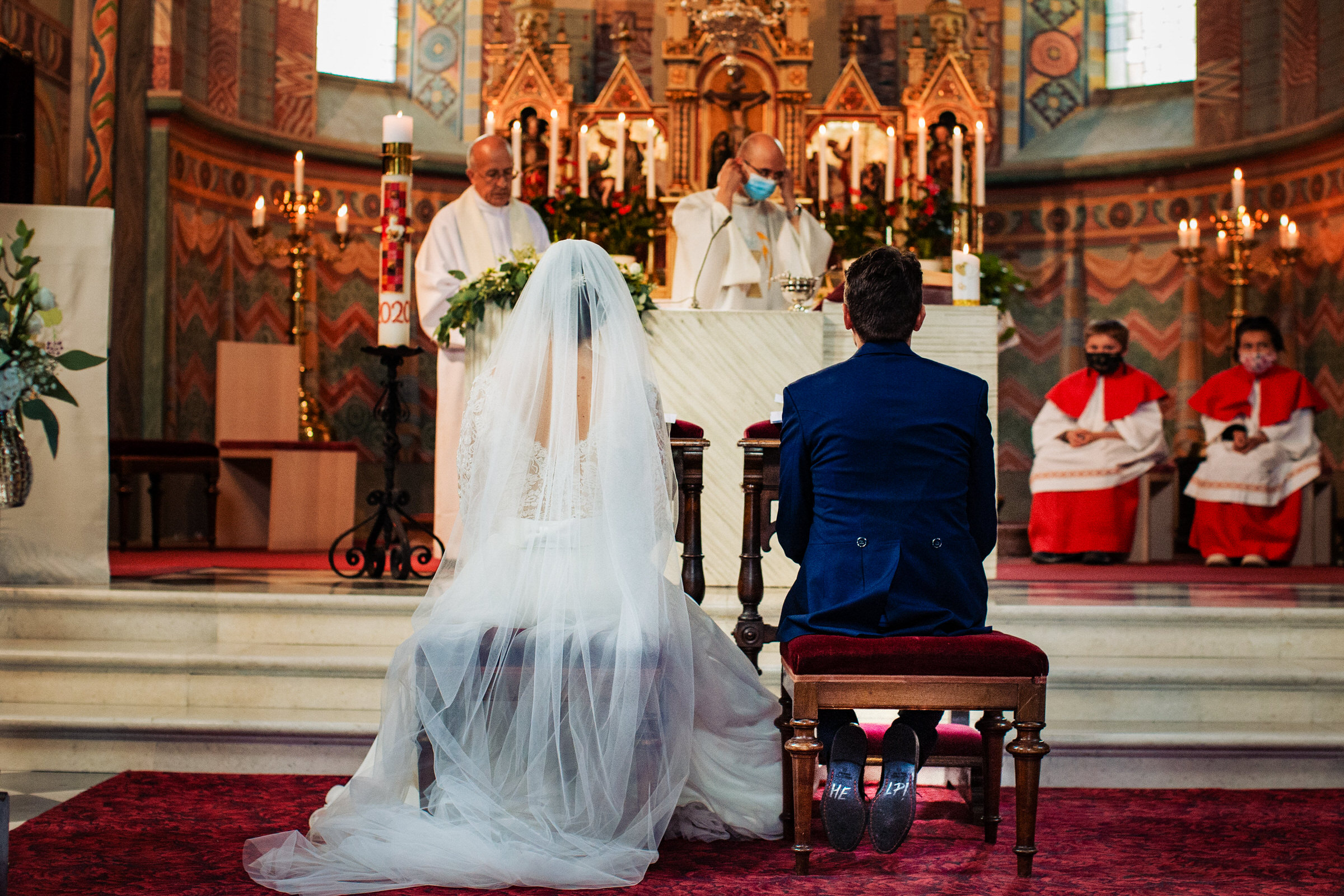 Couple seated at altar - photo by Luca + Marta Gallizio Photography