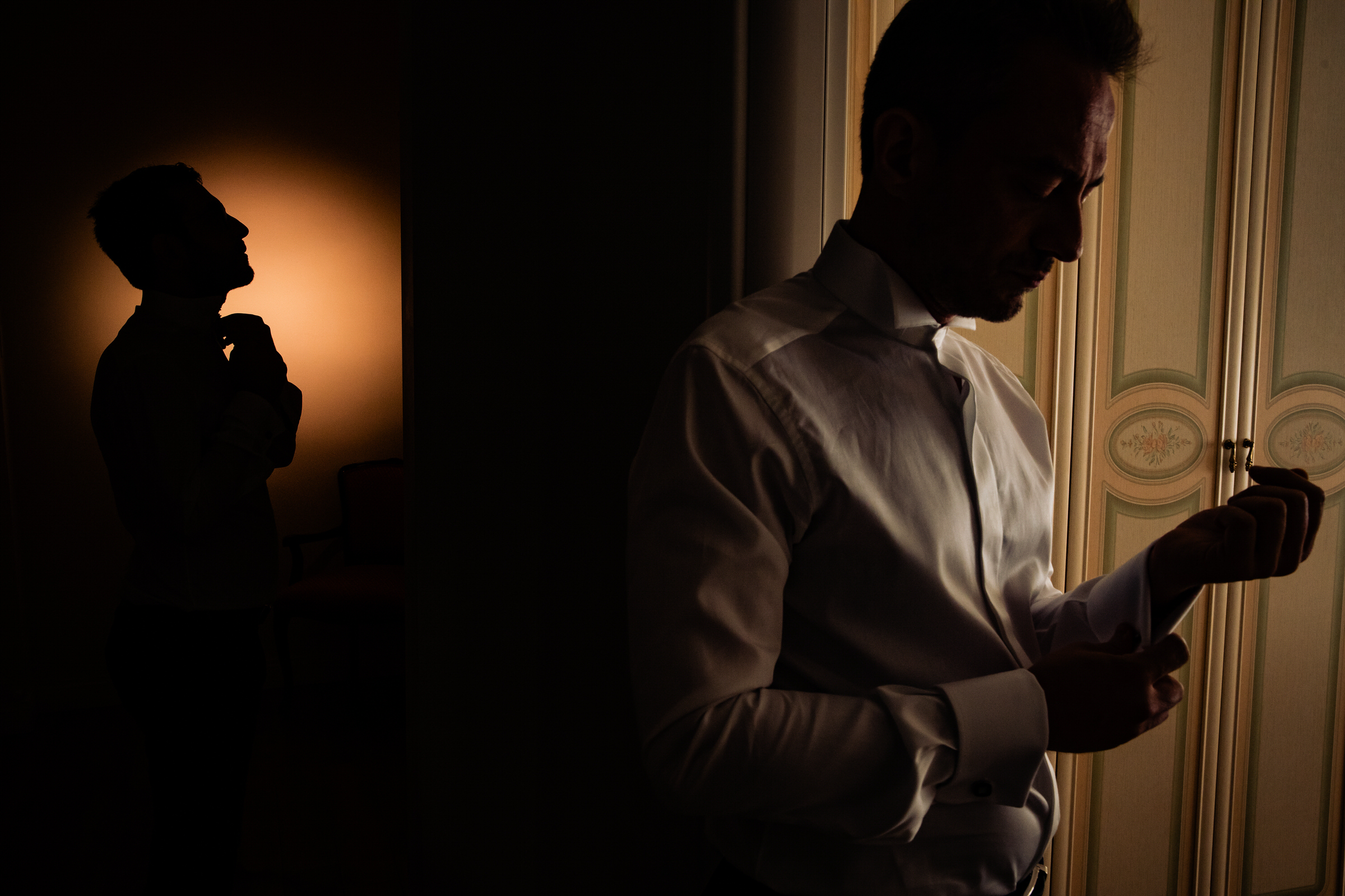 Grooms getting ready in shadow and silhouette - photo by Luca + Marta Gallizio Photography
