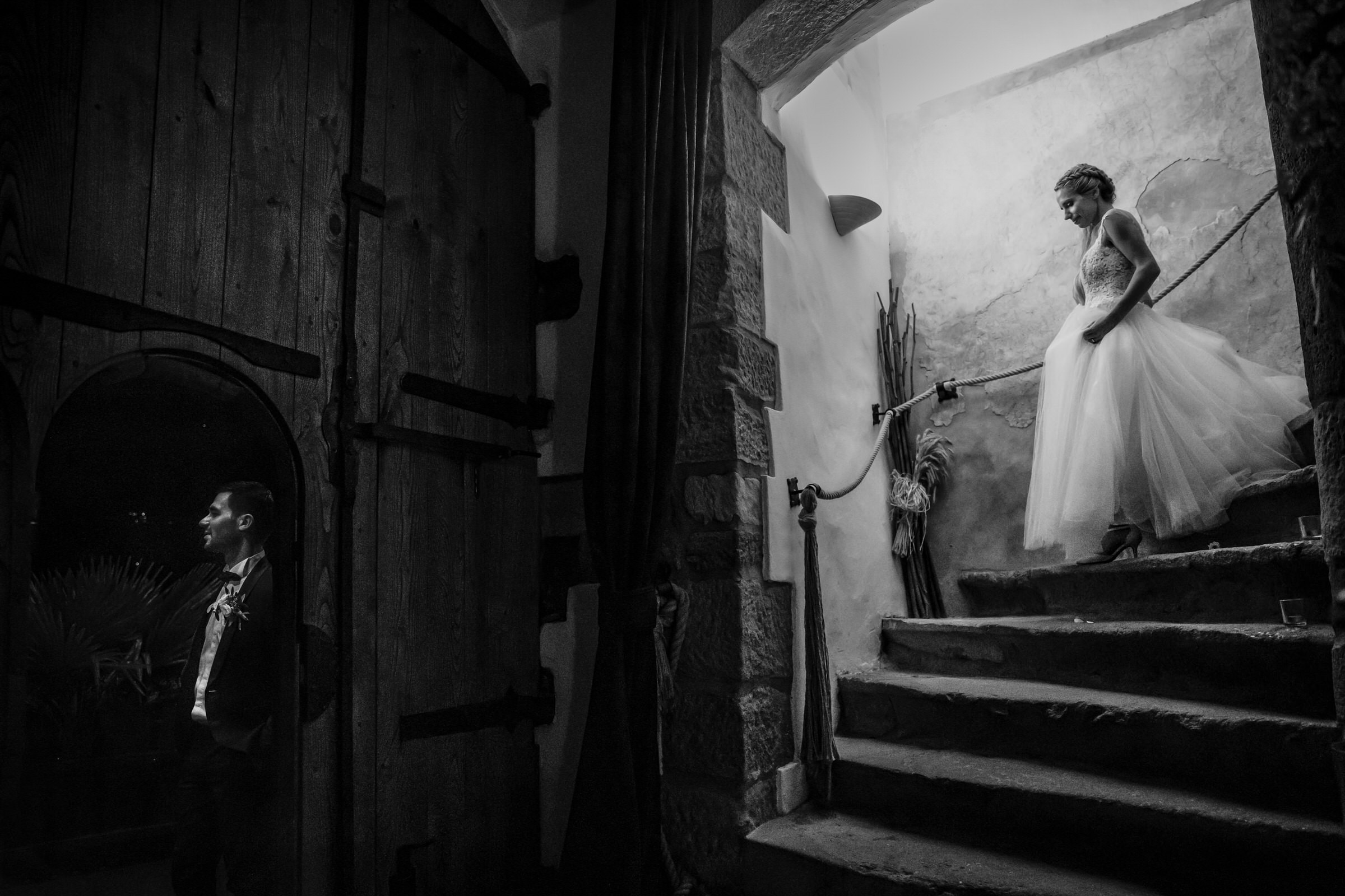 Bride descending stairs to groom - photo by Luca + Marta Gallizio Photography