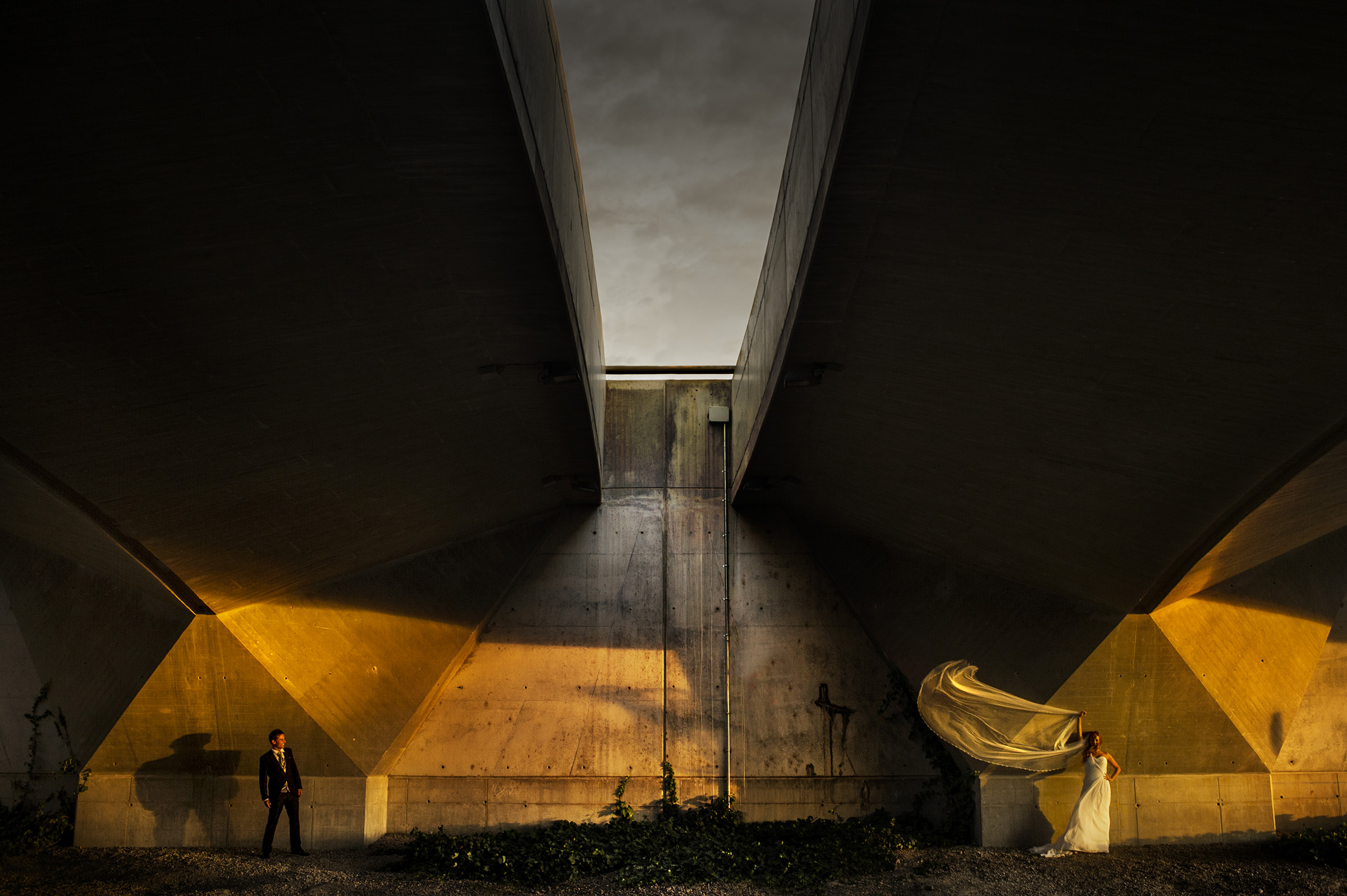 Couple in dramatic architecture and  lighting - photo by Lax Photography