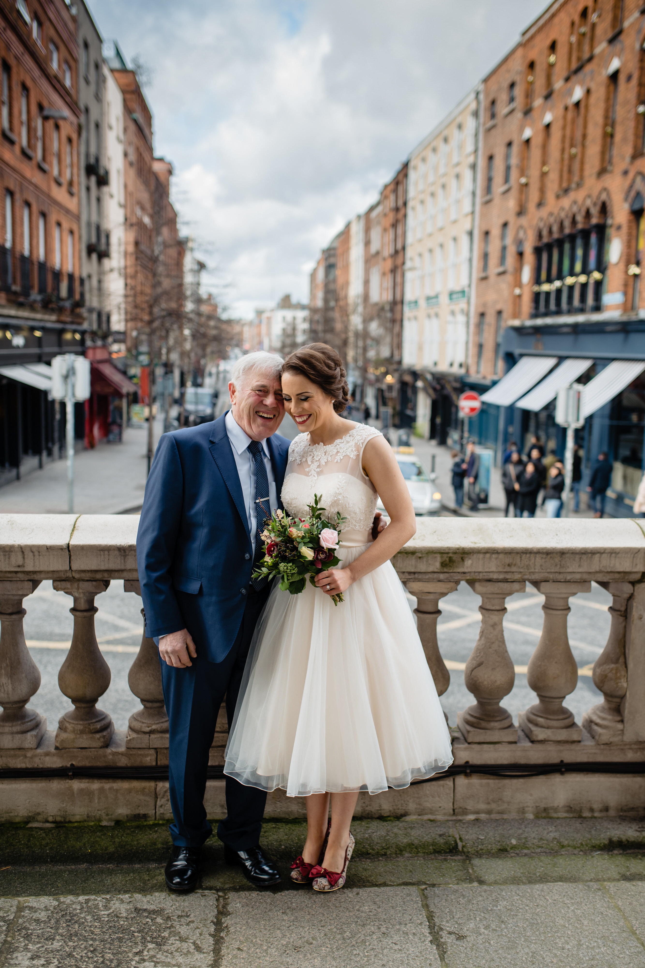 Bride and father at balustrade - photo by John Gillooley