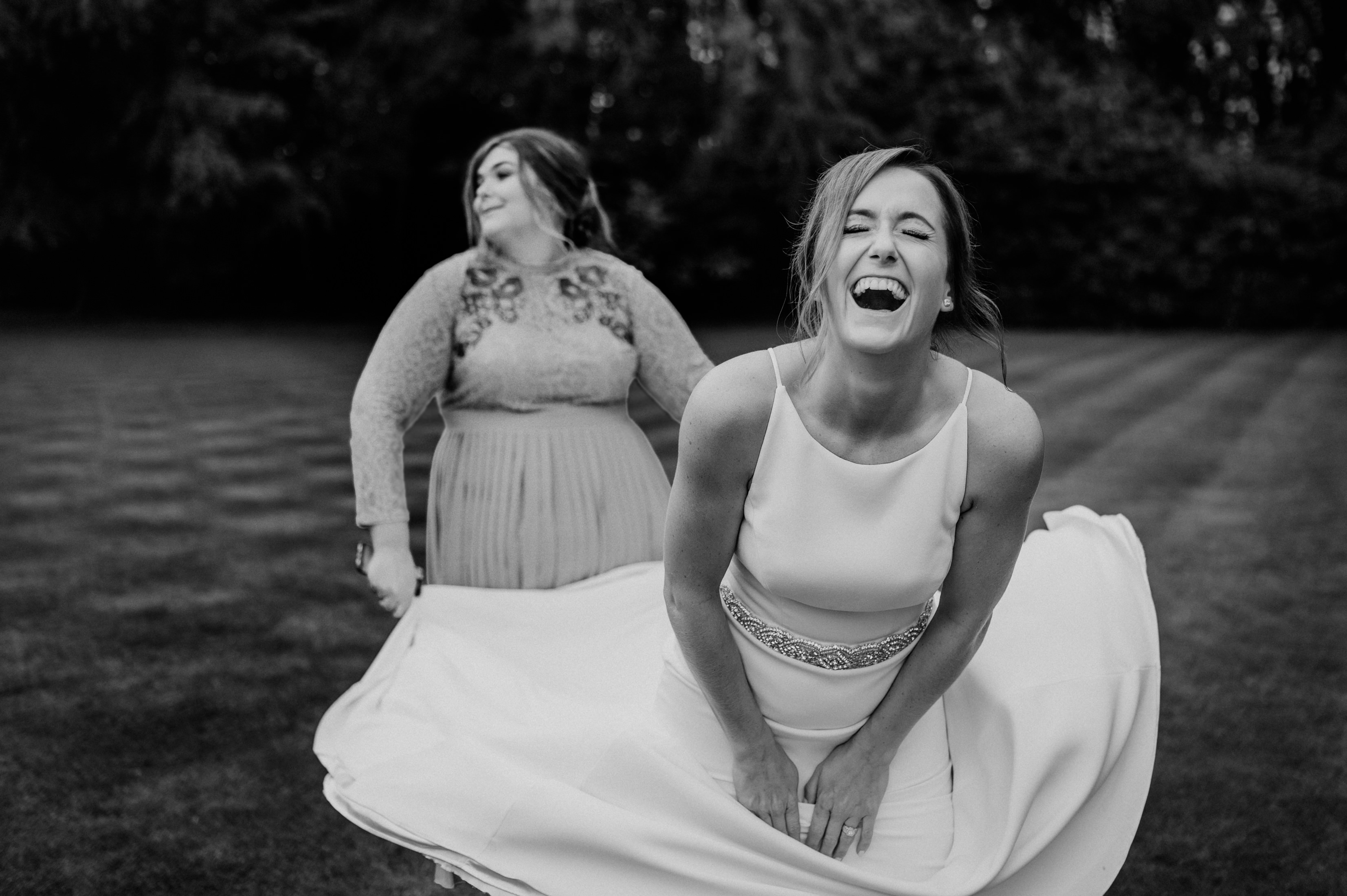 Bride and friend playing around in the garden - photo by John Gillooley