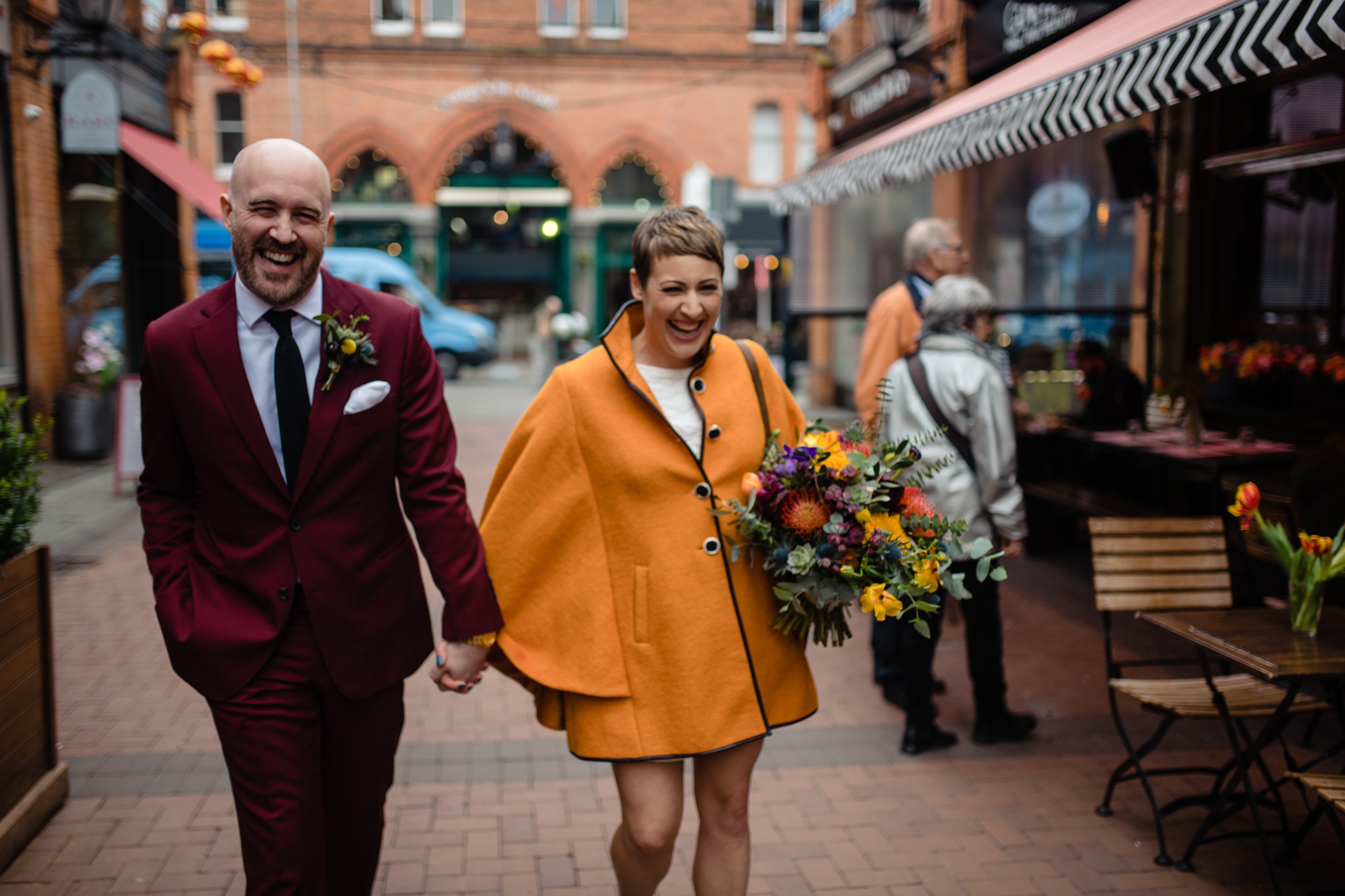 Bride and groom fashion statement in streetscape - photo by John Gillooley
