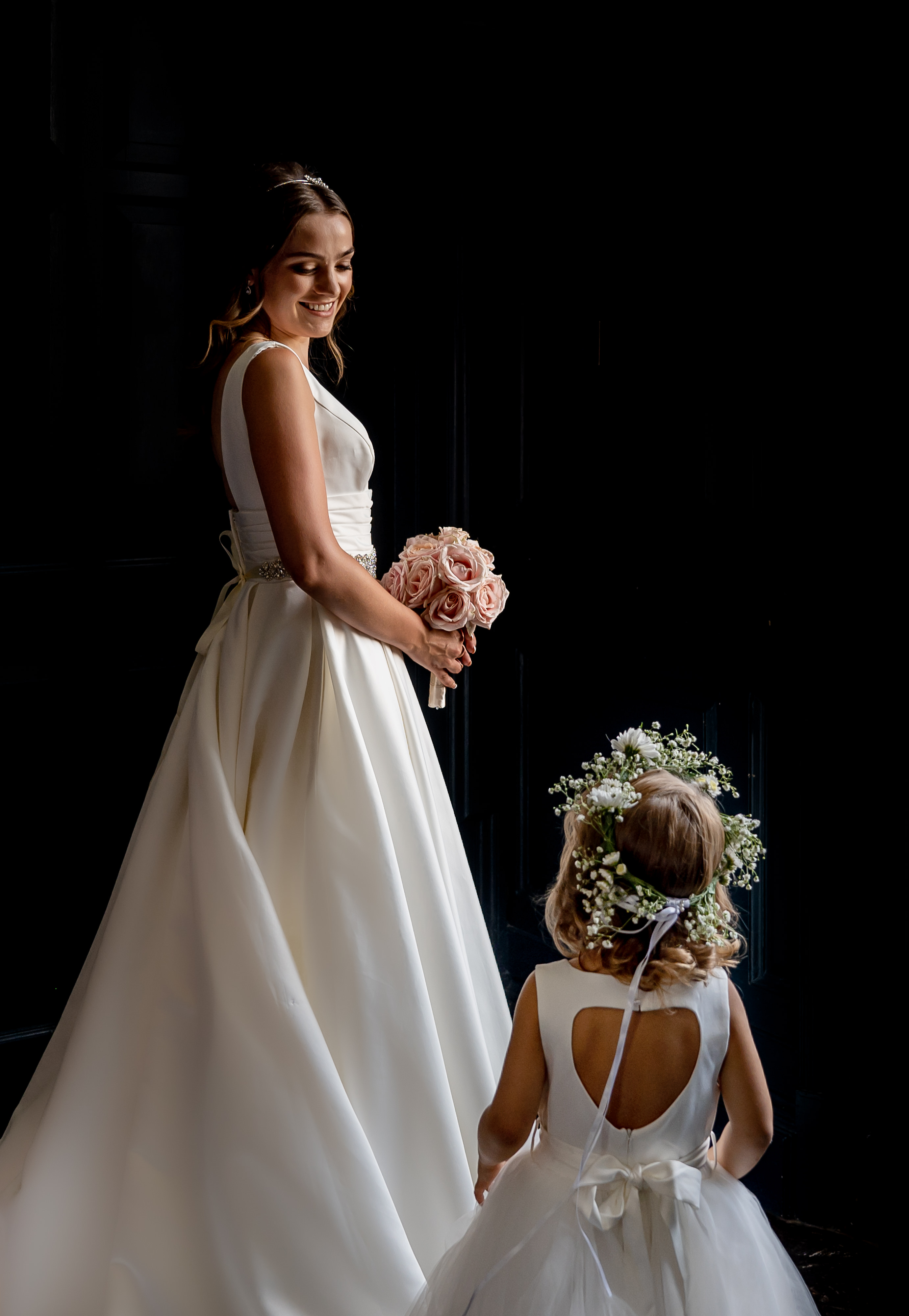 Bride portrait with flower girl - photo by John Gillooley