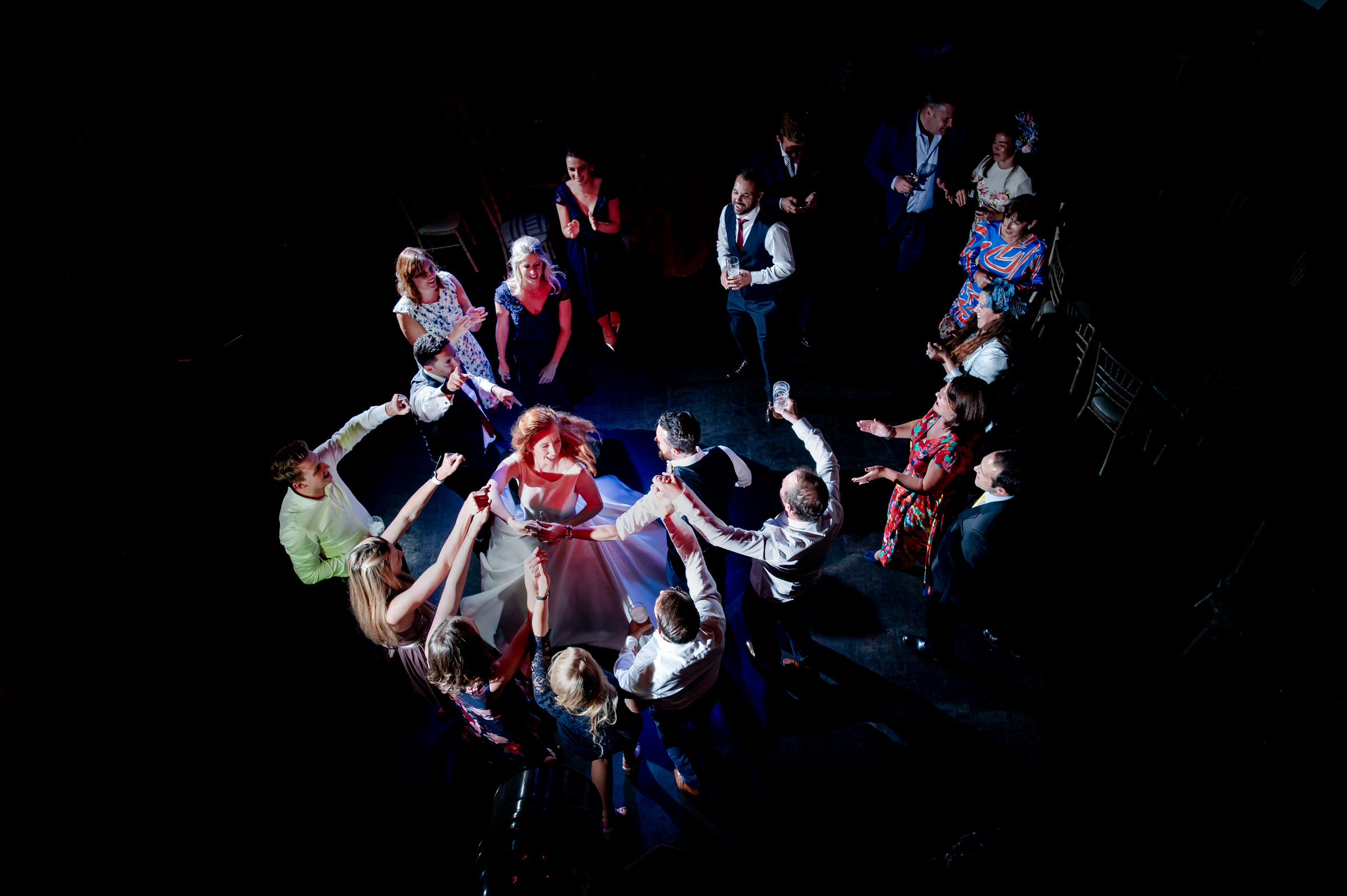 aerial view of couple and guests dancing - photo by John Gillooley