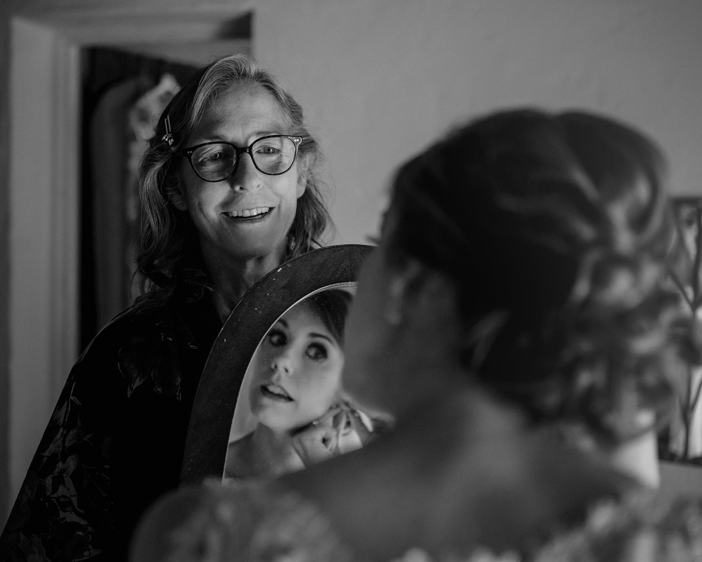 Bride in  mirror and mother - photo by John Gillooley