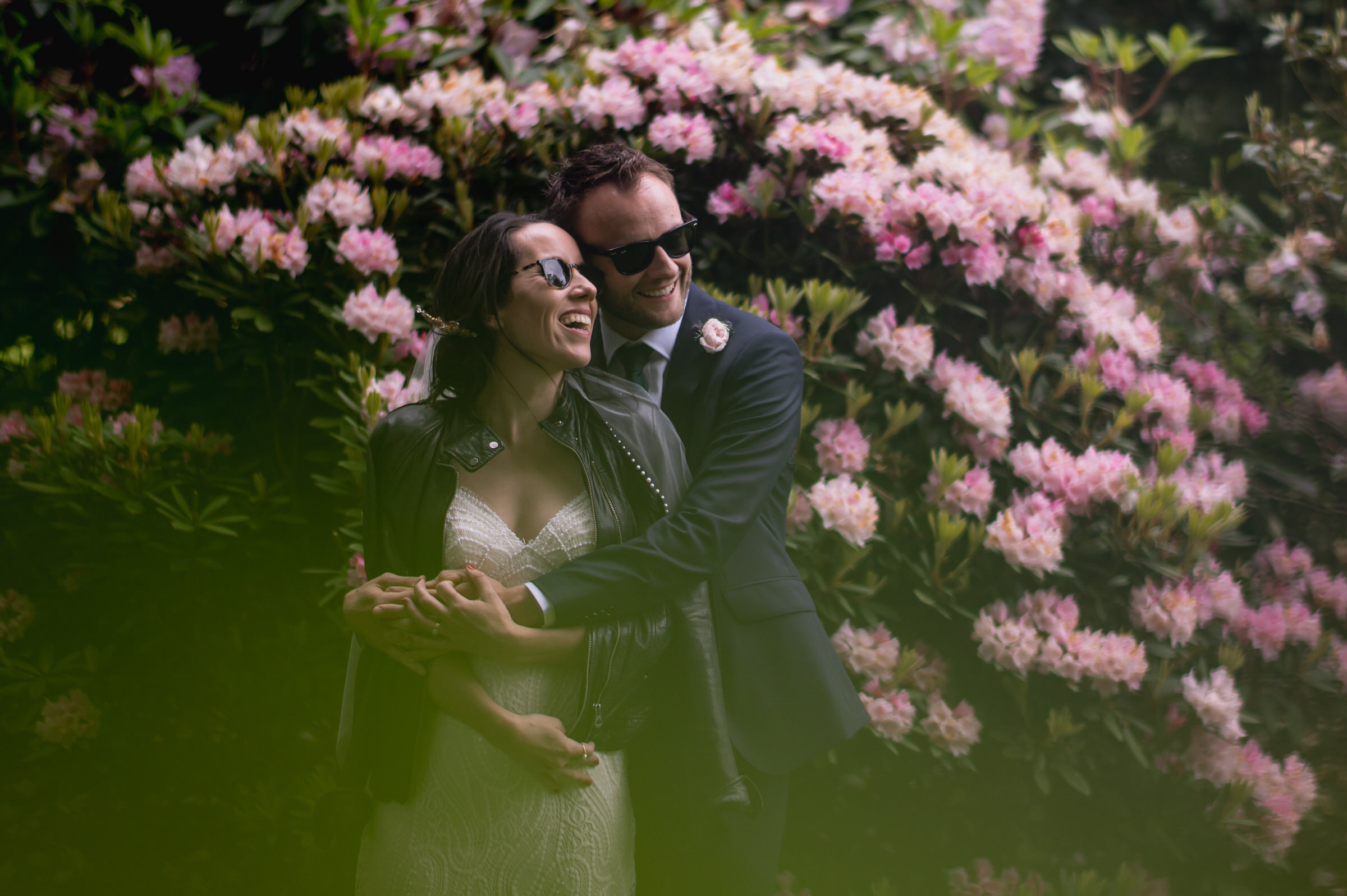 Couple portrait against rhododendron - photo by John Gillooley