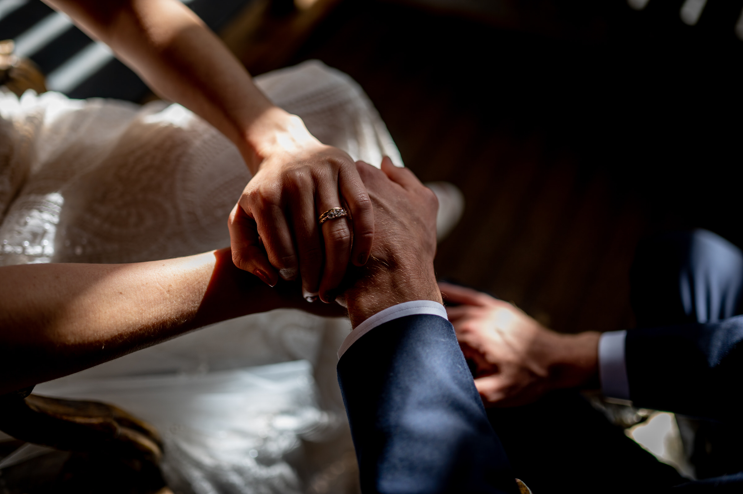 Couple's hands - photo by John Gillooley
