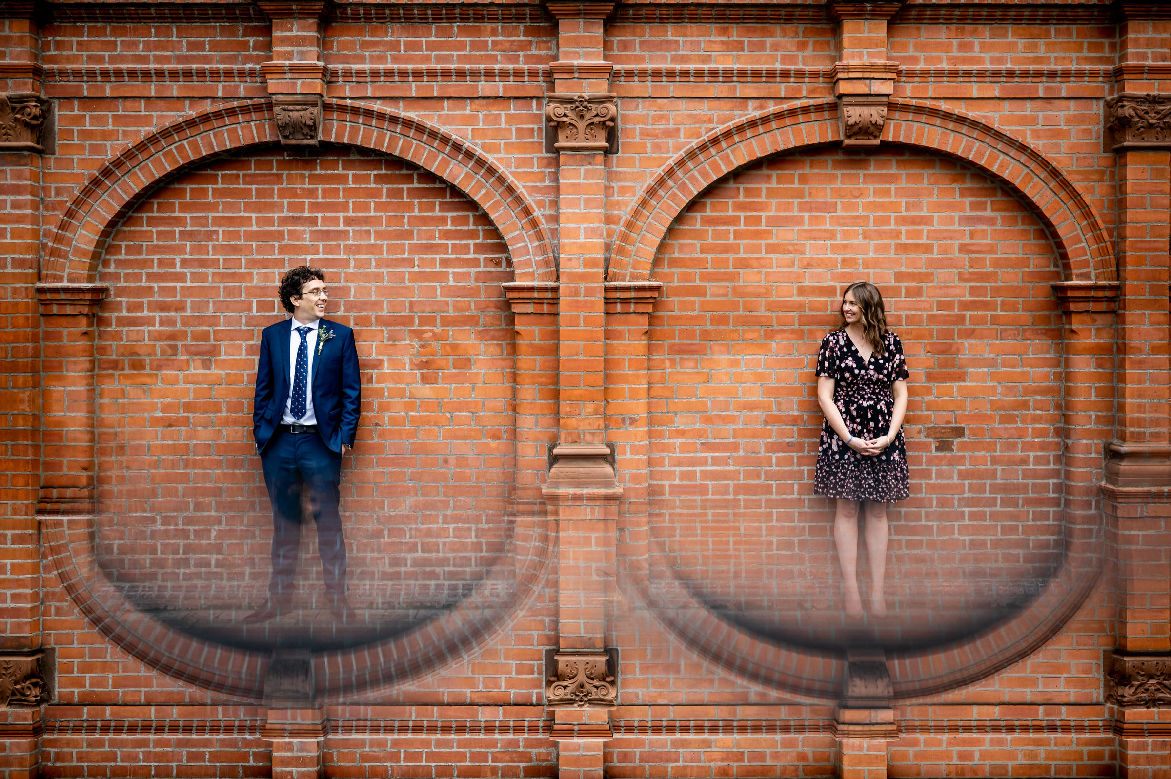 Engagement couple cameos in brick architecture - photo by John Gillooley