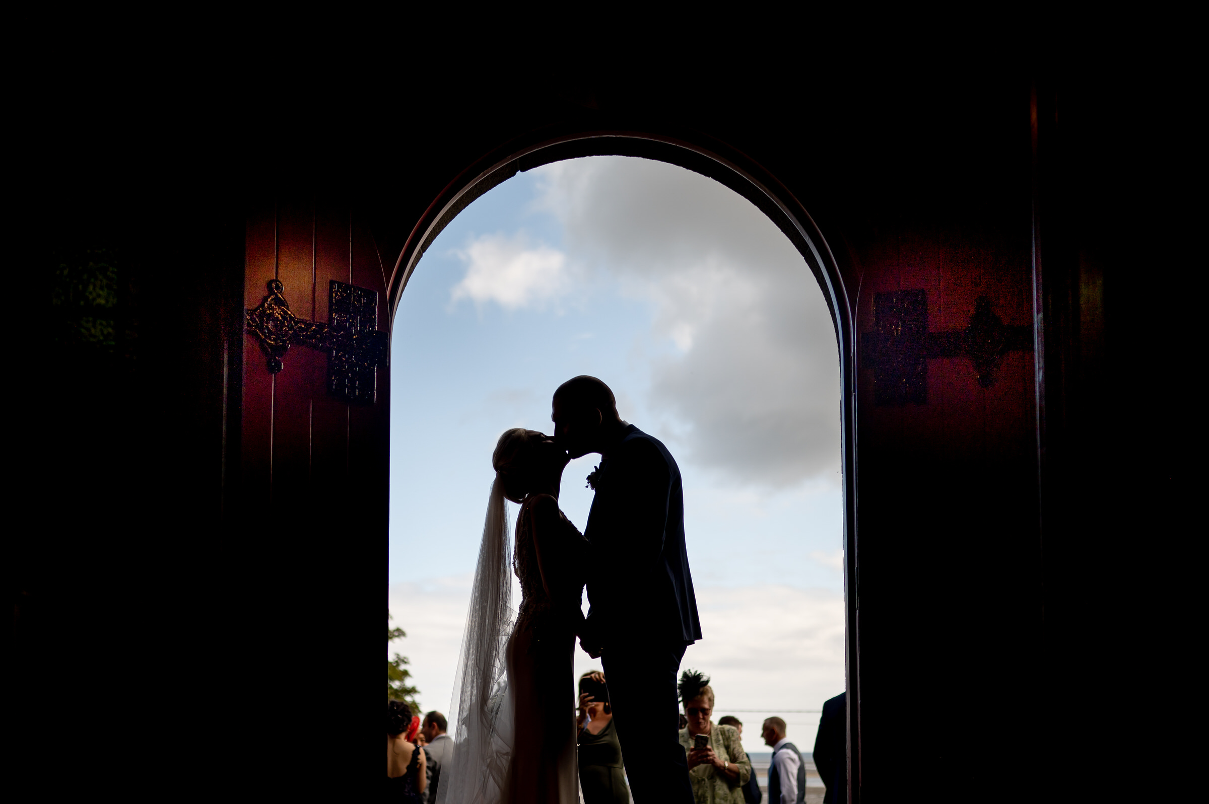 Silhouette kiss in archway - photo by John Gillooley