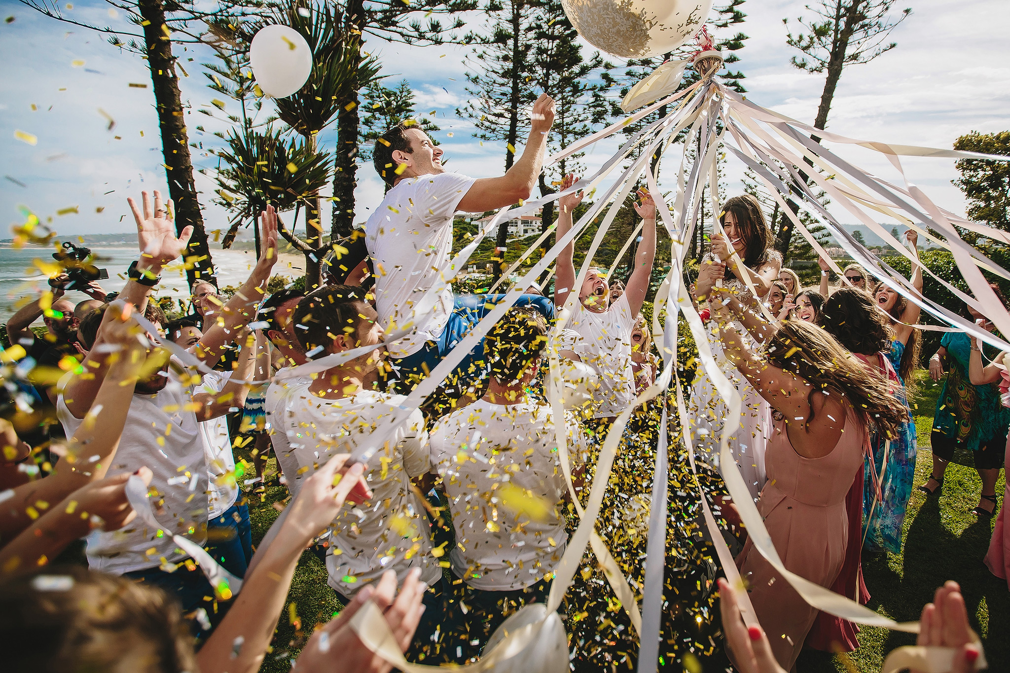 Bride and groom aloft in outdoor play - photo by Ruan Redelinghuys Photography