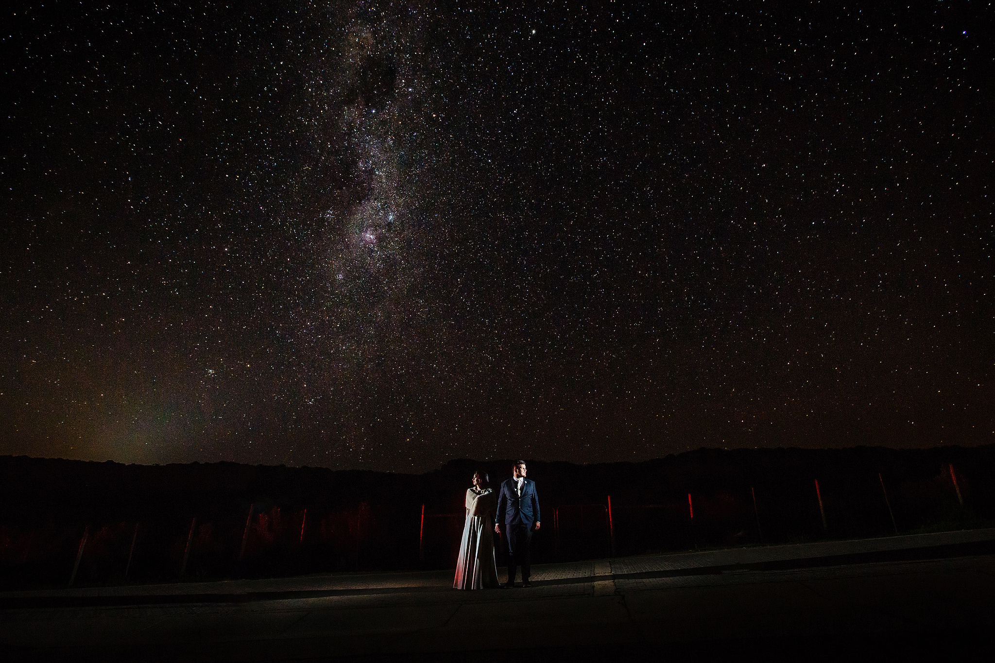 Couple against starry sky - photo by Ruan Redelinghuys Photography