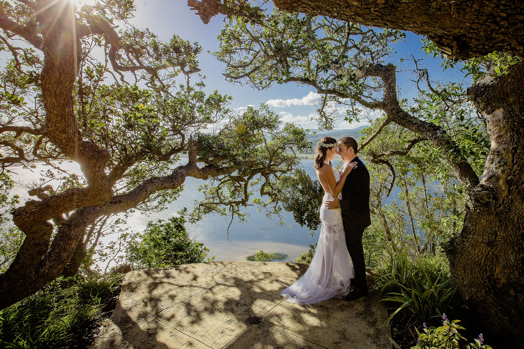 Couple amidst live oaks - photo by Ruan Redelinghuys Photography