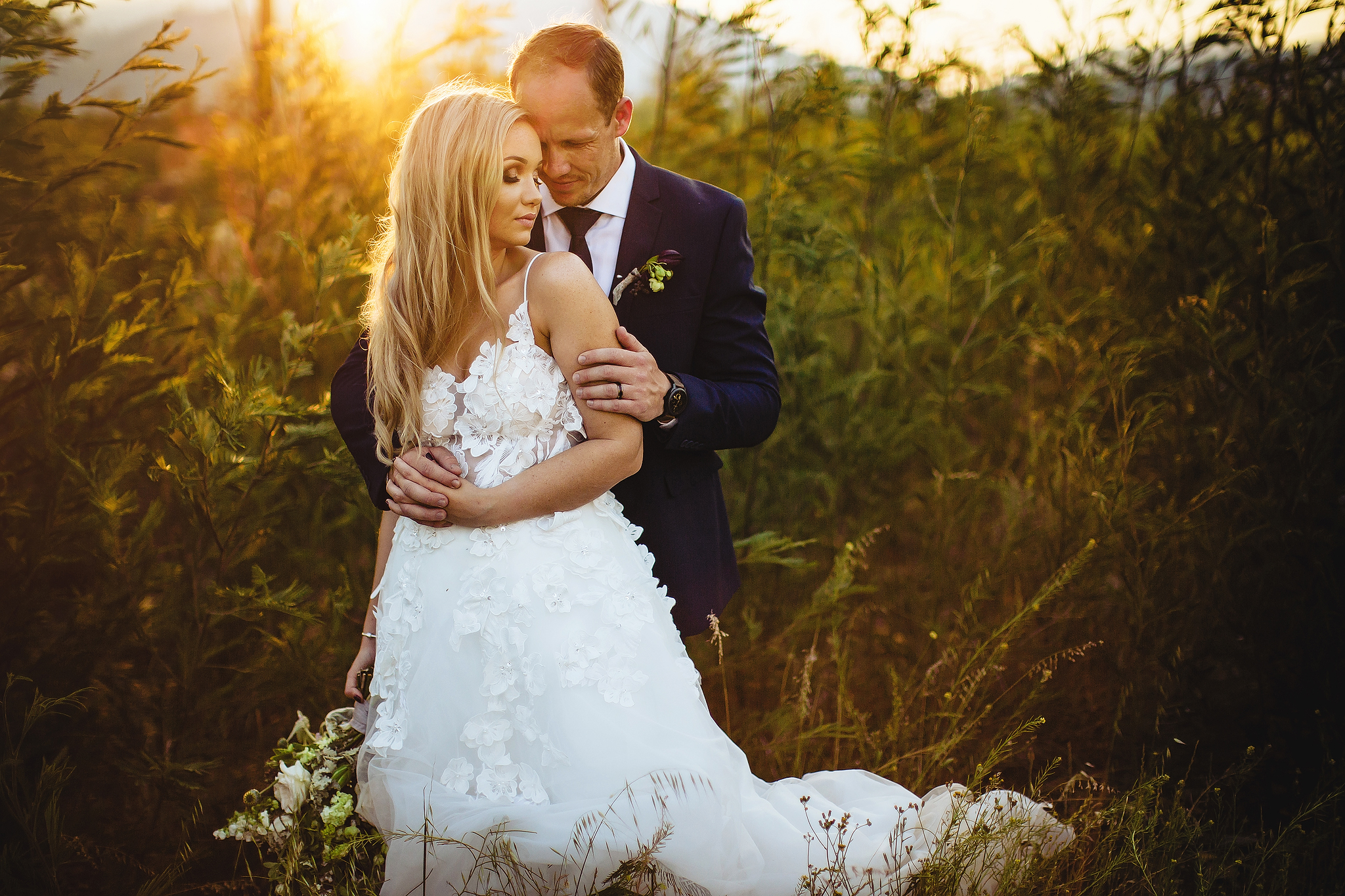 Couple portrait amidst foliage and afternoon sun - photo by Ruan Redelinghuys Photography
