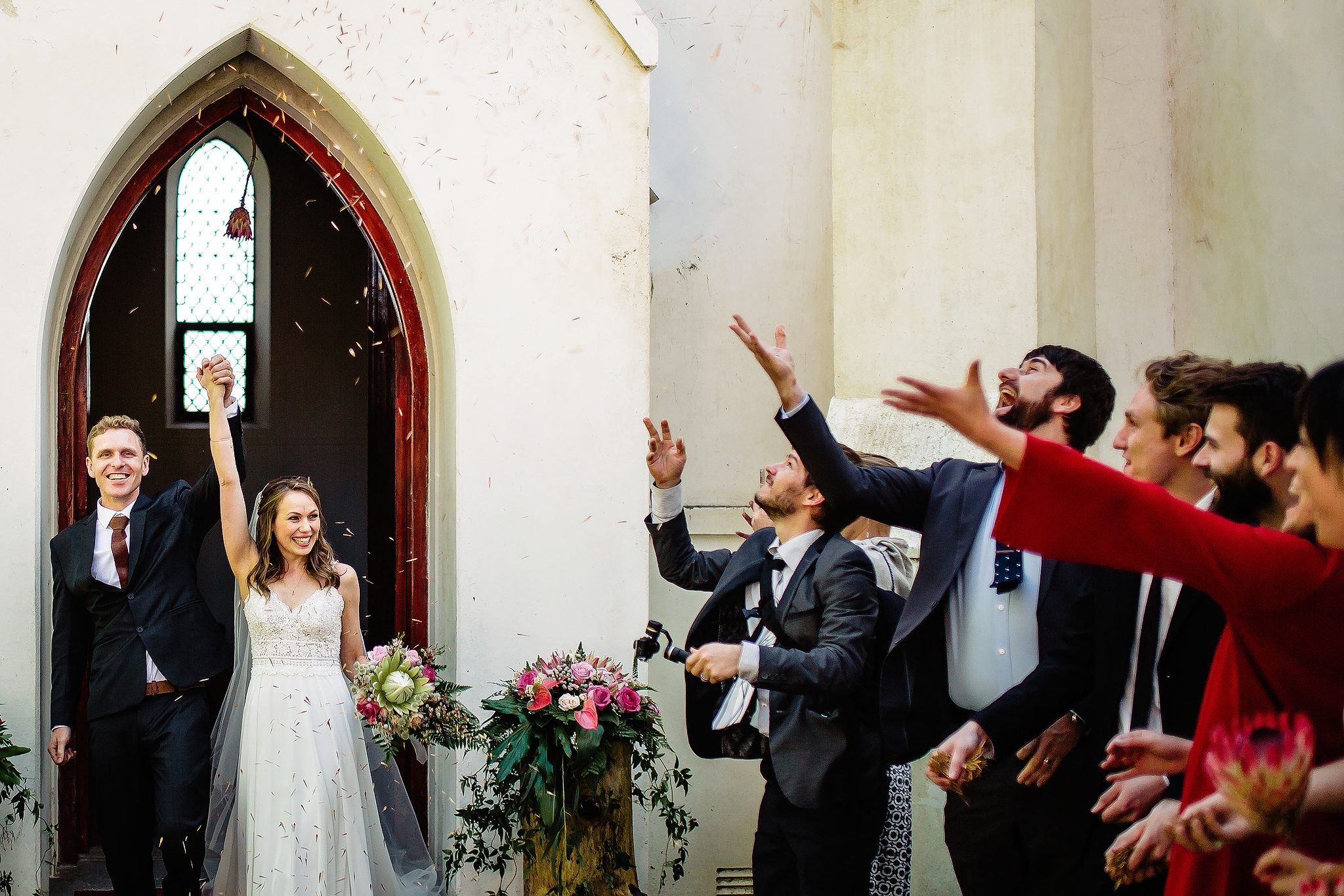 Couple showered by well-wishers leaving the church - photo by Ruan Redelinghuys Photography