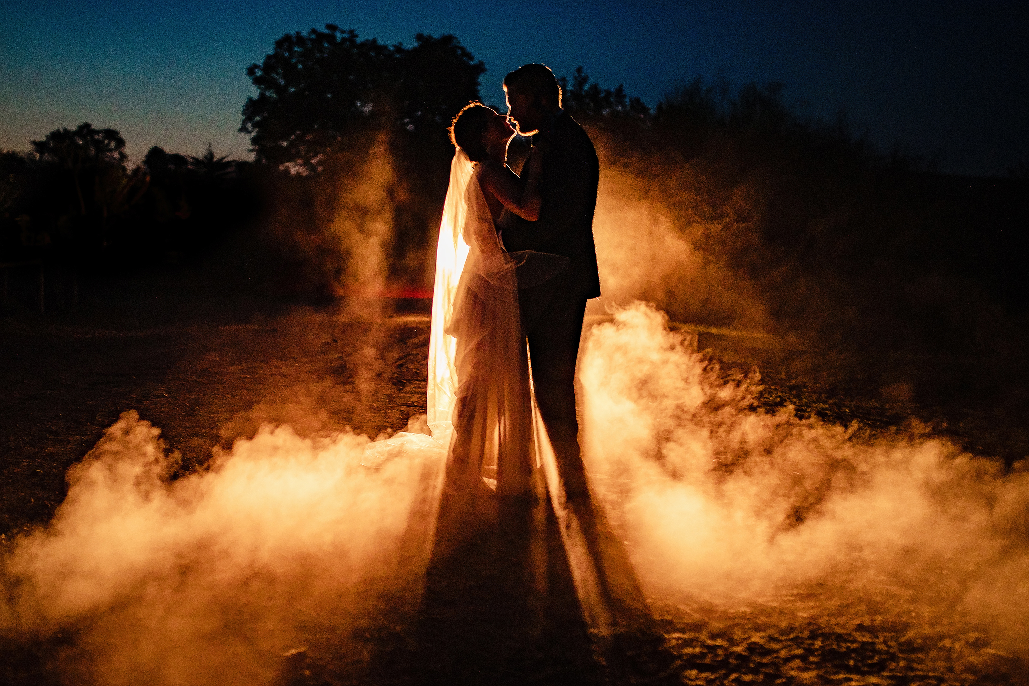 Couple silhouette in smoke - photo by Ruan Redelinghuys Photography