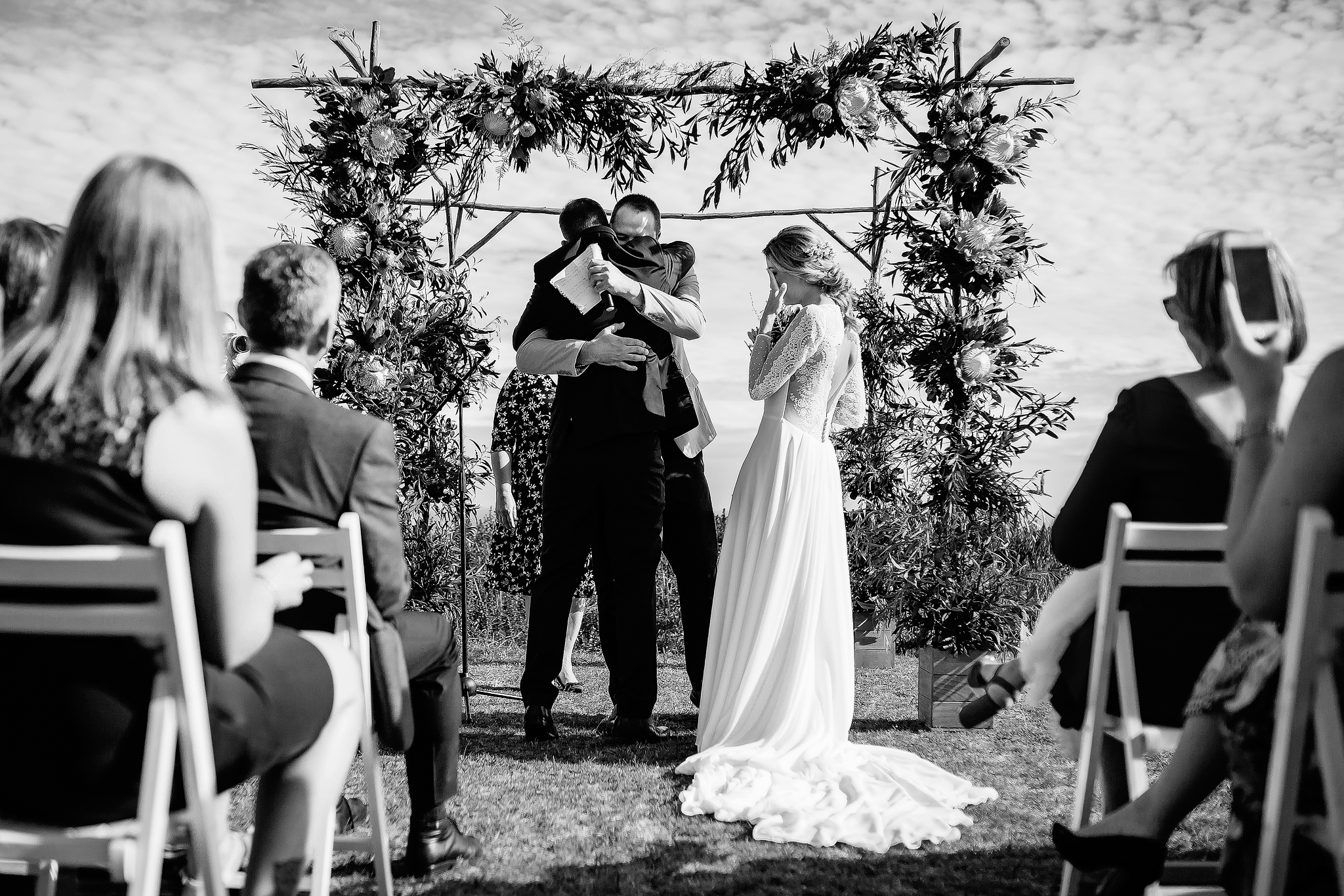 Emotional moment and embrace for groom at ceremony - photo by Ruan Redelinghuys Photography