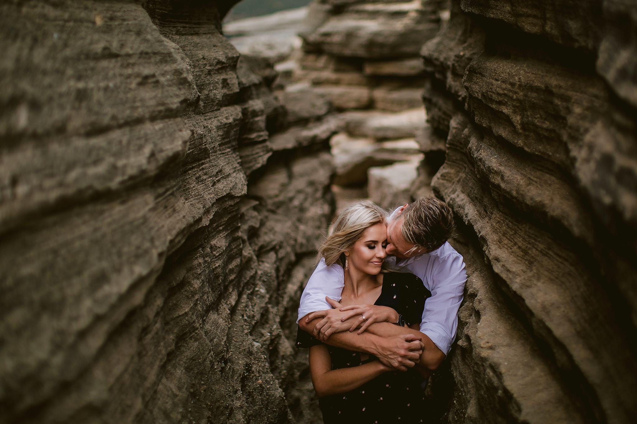 Engagement couple among the rocks - photo by Ruan Redelinghuys Photography