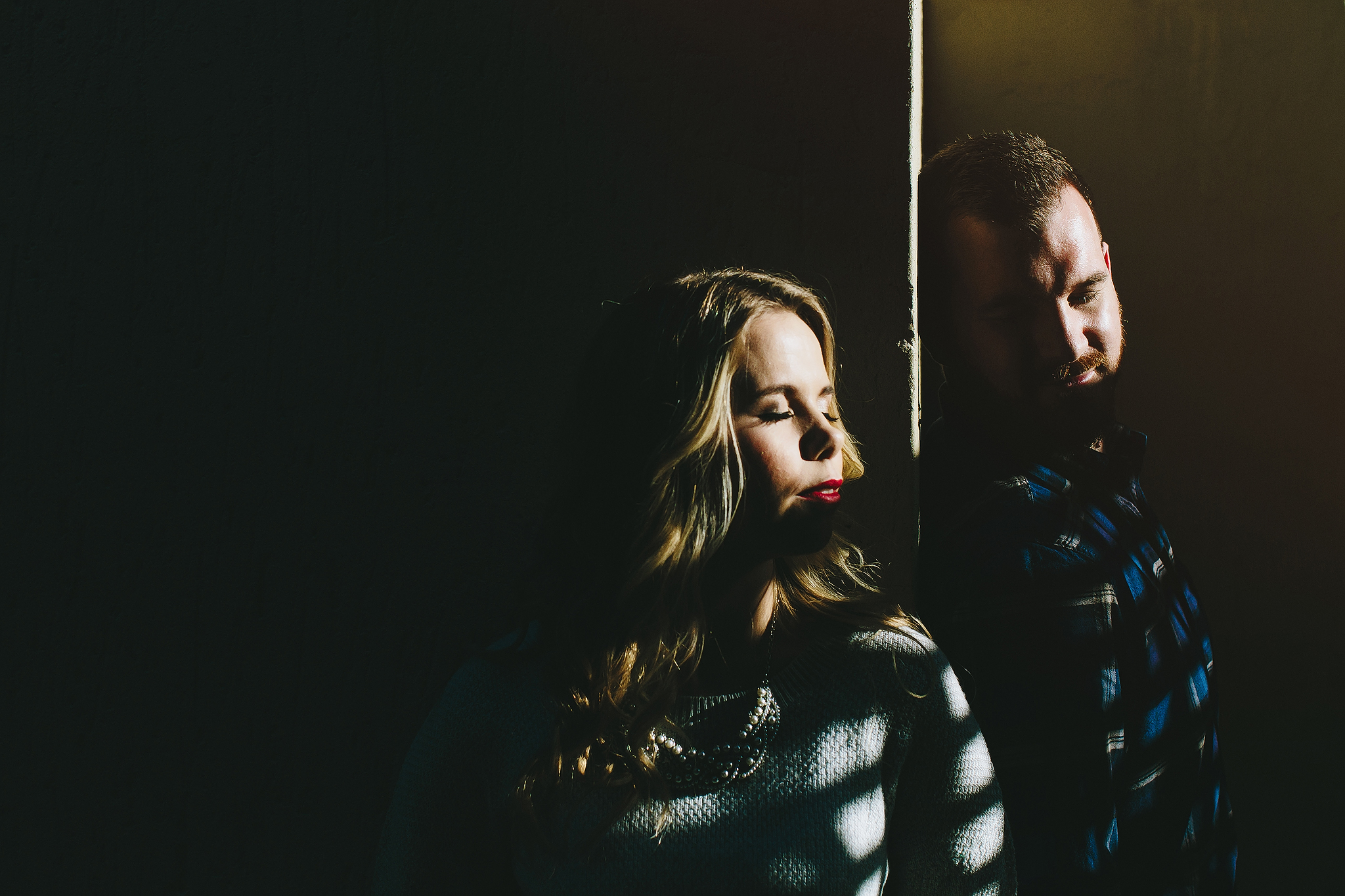 Engagement couple in striped shadows - photo by Ruan Redelinghuys Photography