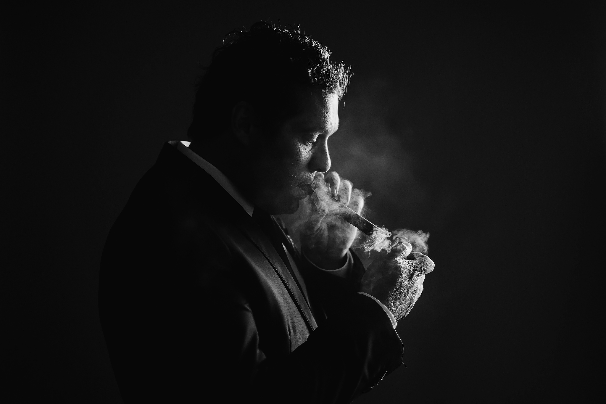 Groom lighting his cigar - photo by Ruan Redelinghuys Photography - South Africa
