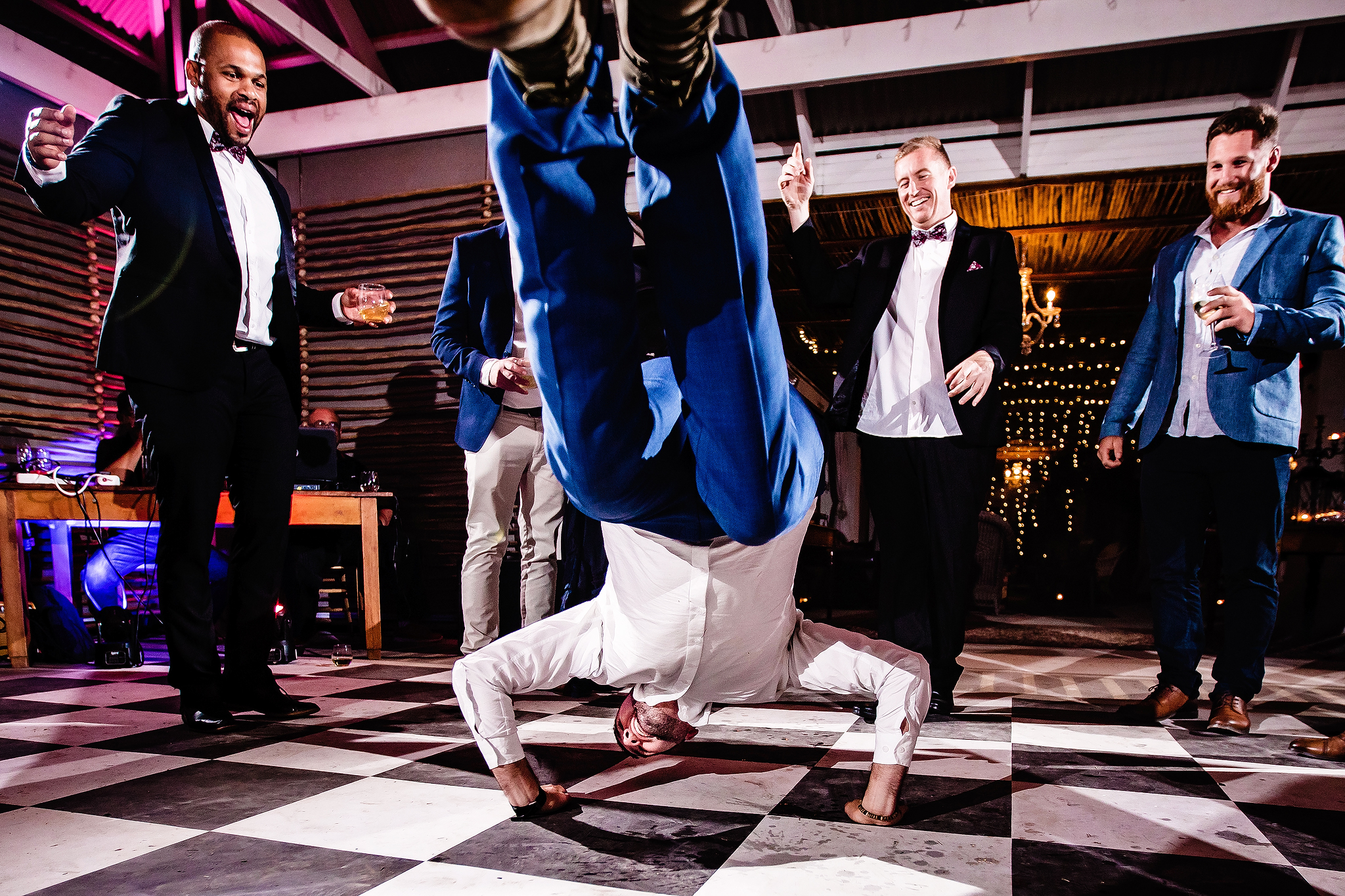 Groom spins on his head - photo by Ruan Redelinghuys Photography