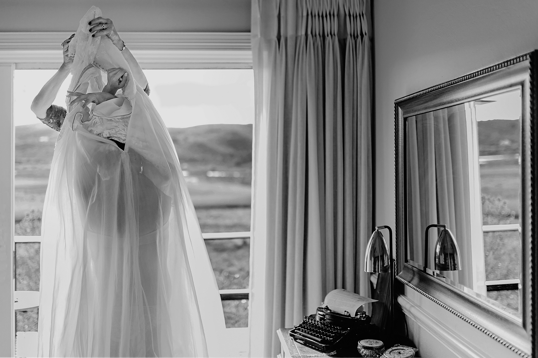Helping bride into her gown - photo by Ruan Redelinghuys Photography