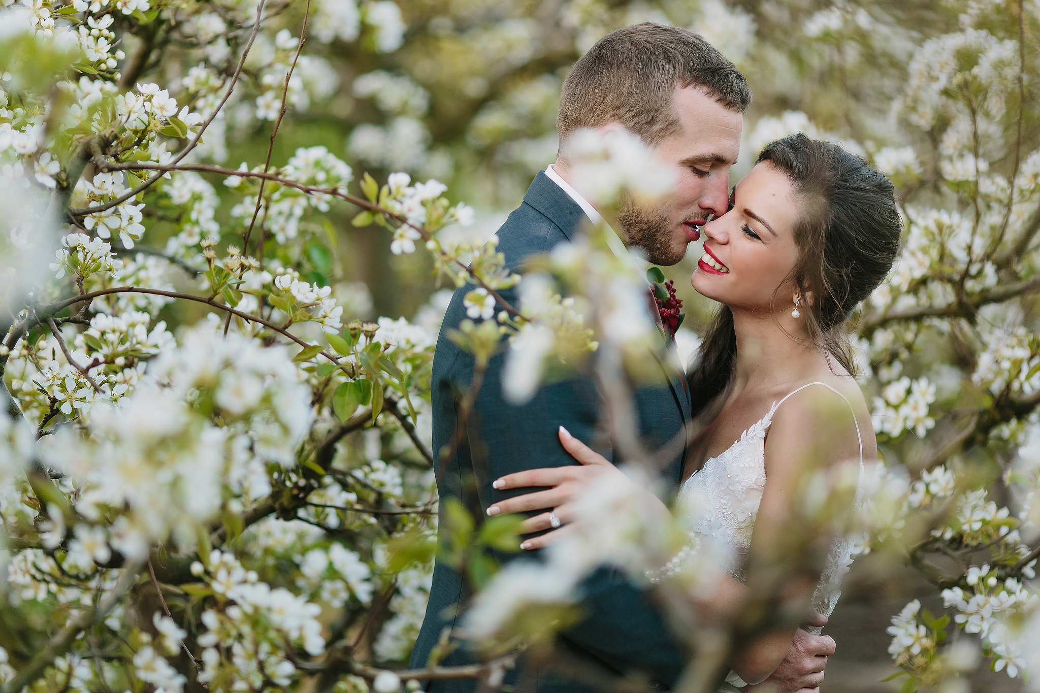 Kiss among the blossoms - photo by Ruan Redelinghuys Photography