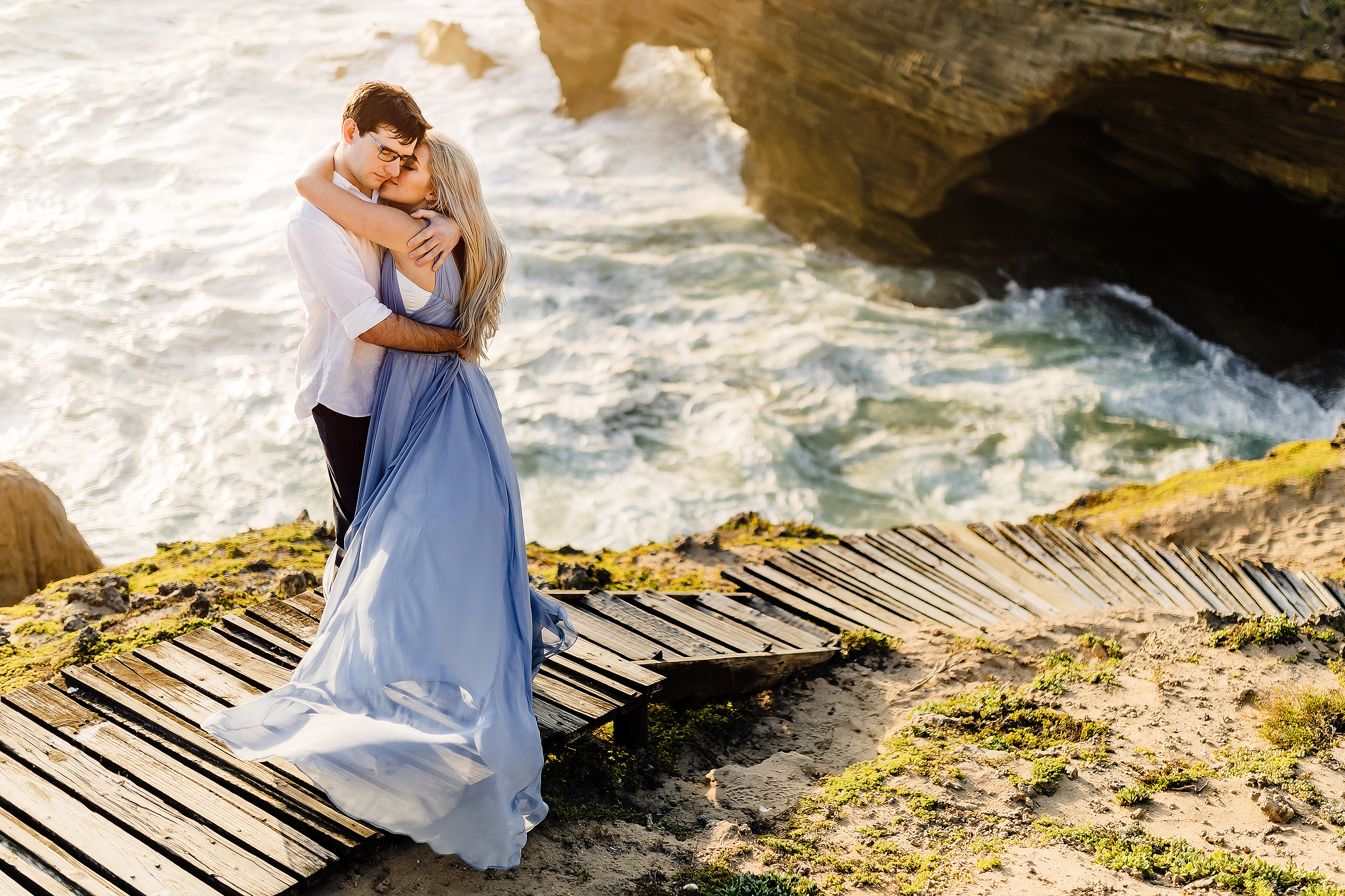 Romantic engagement embrace by the sea - photo by Ruan Redelinghuys Photography