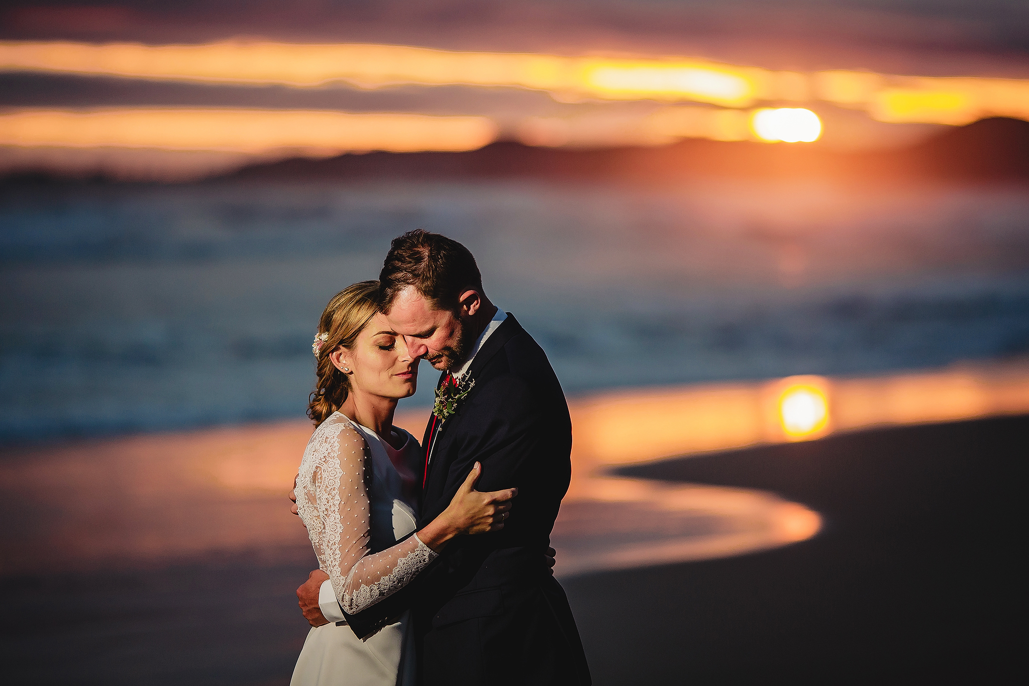 Sunset face to face embrace - photo by Ruan Redelinghuys Photography