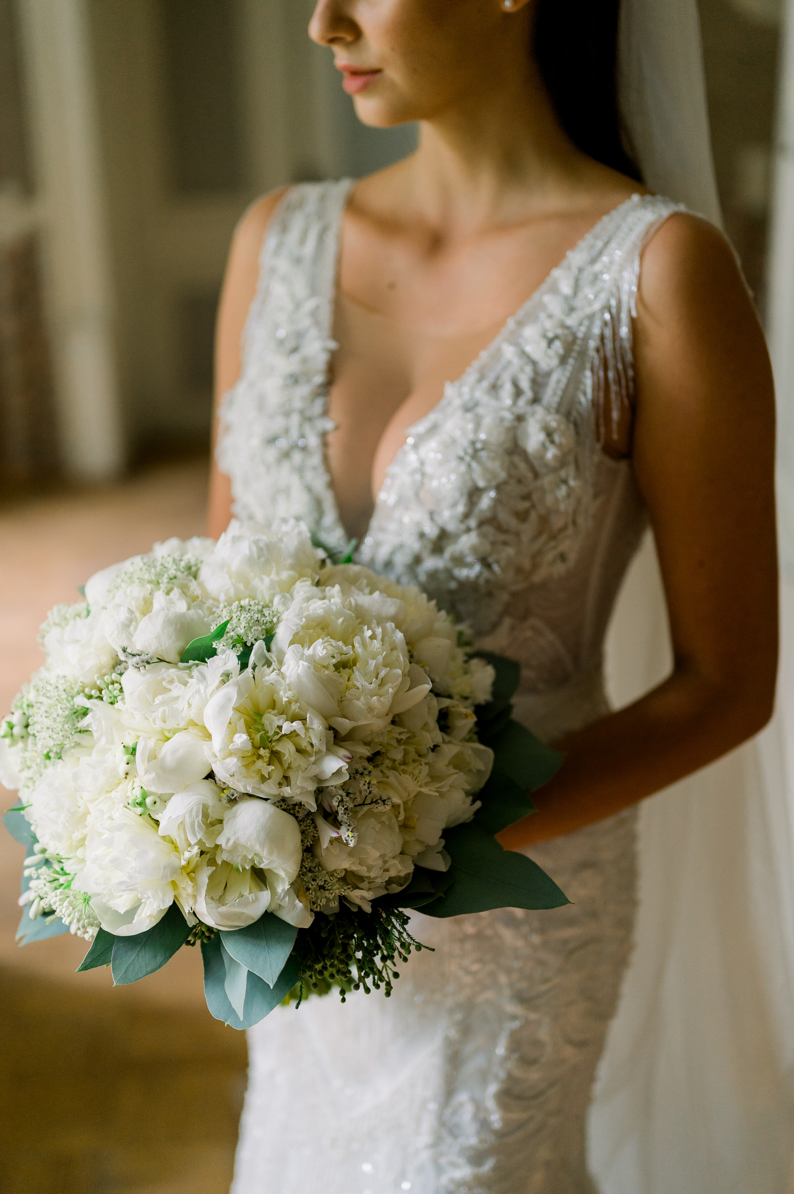 Glamorous bride in beaded gown - photo by M&J Studios