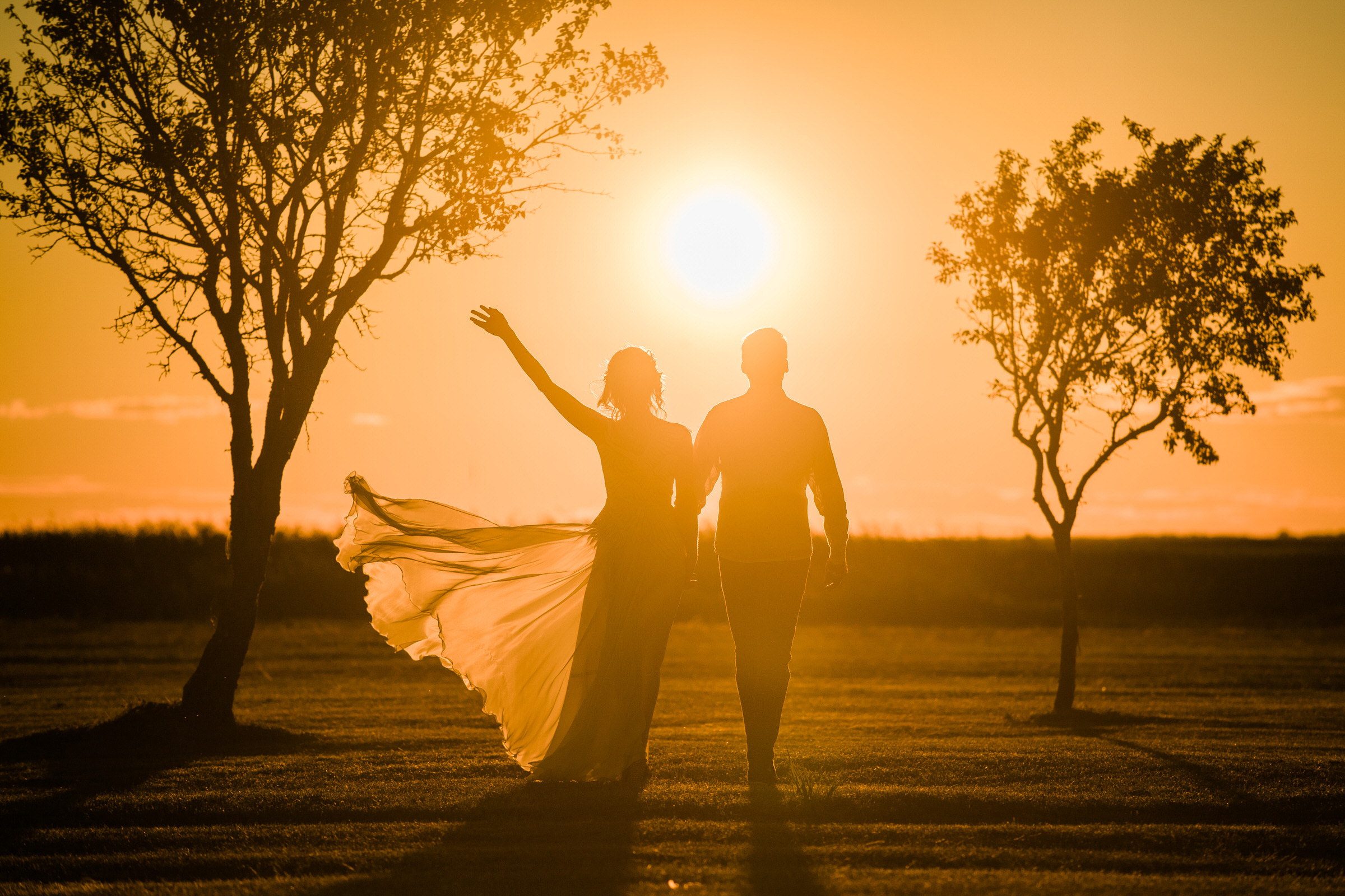 Silhouette couple against afternoon sun in Estonia - photo by M&J Studios