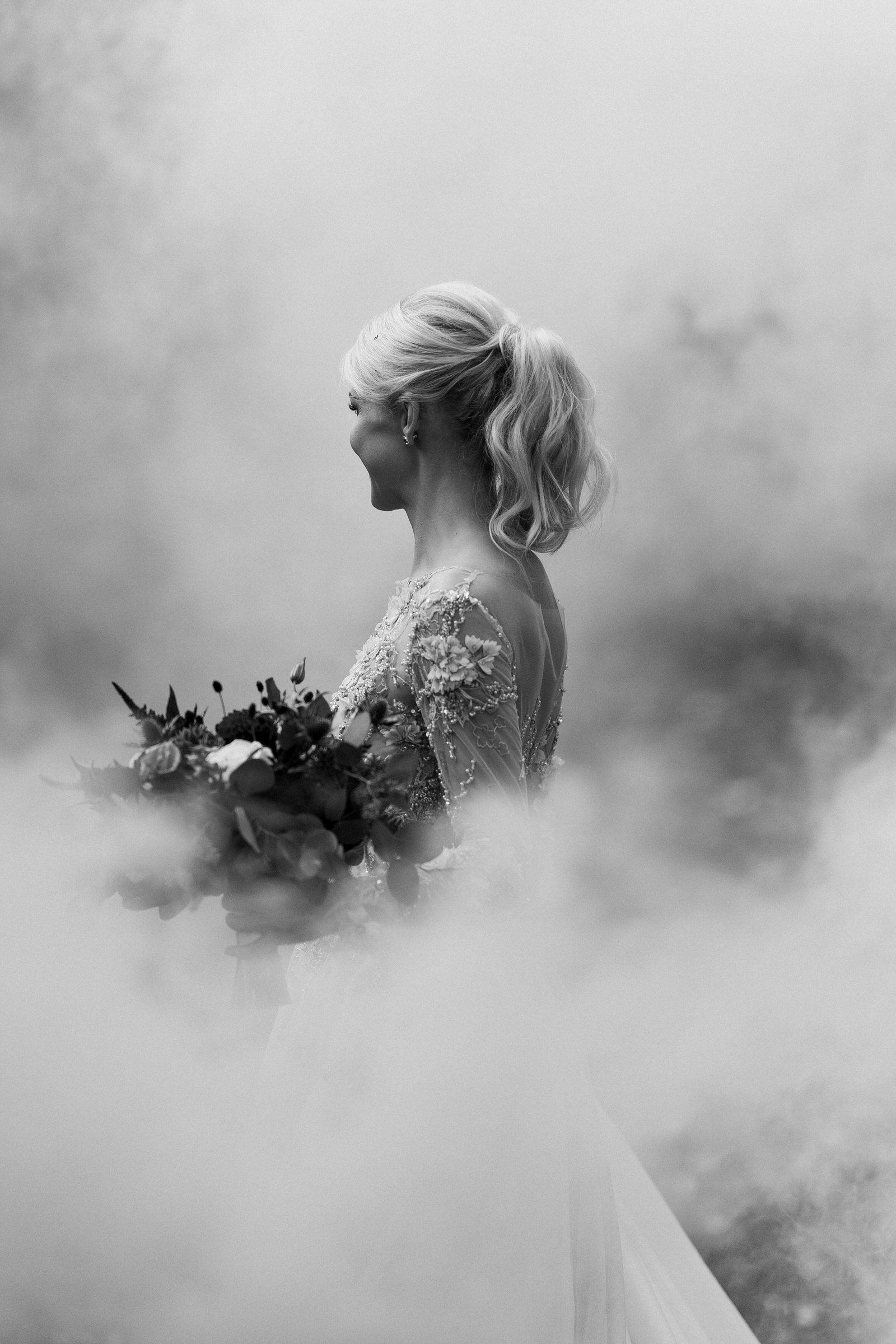 Three quarters portrait bride in cloud in Estonia - photo by M&J Studios