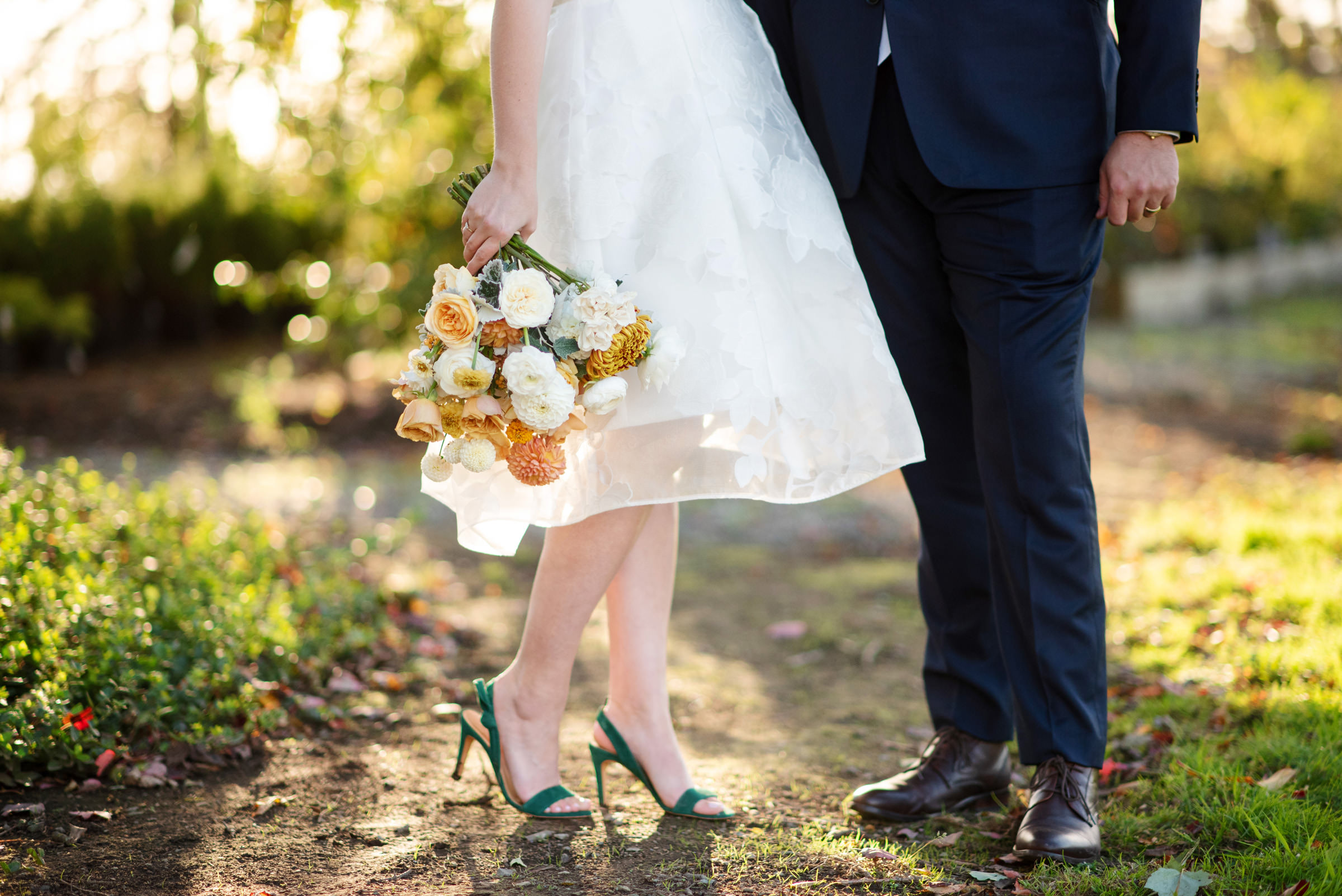 Closeup off bride shoes and bouquet - photo by Barbie Hull Photography