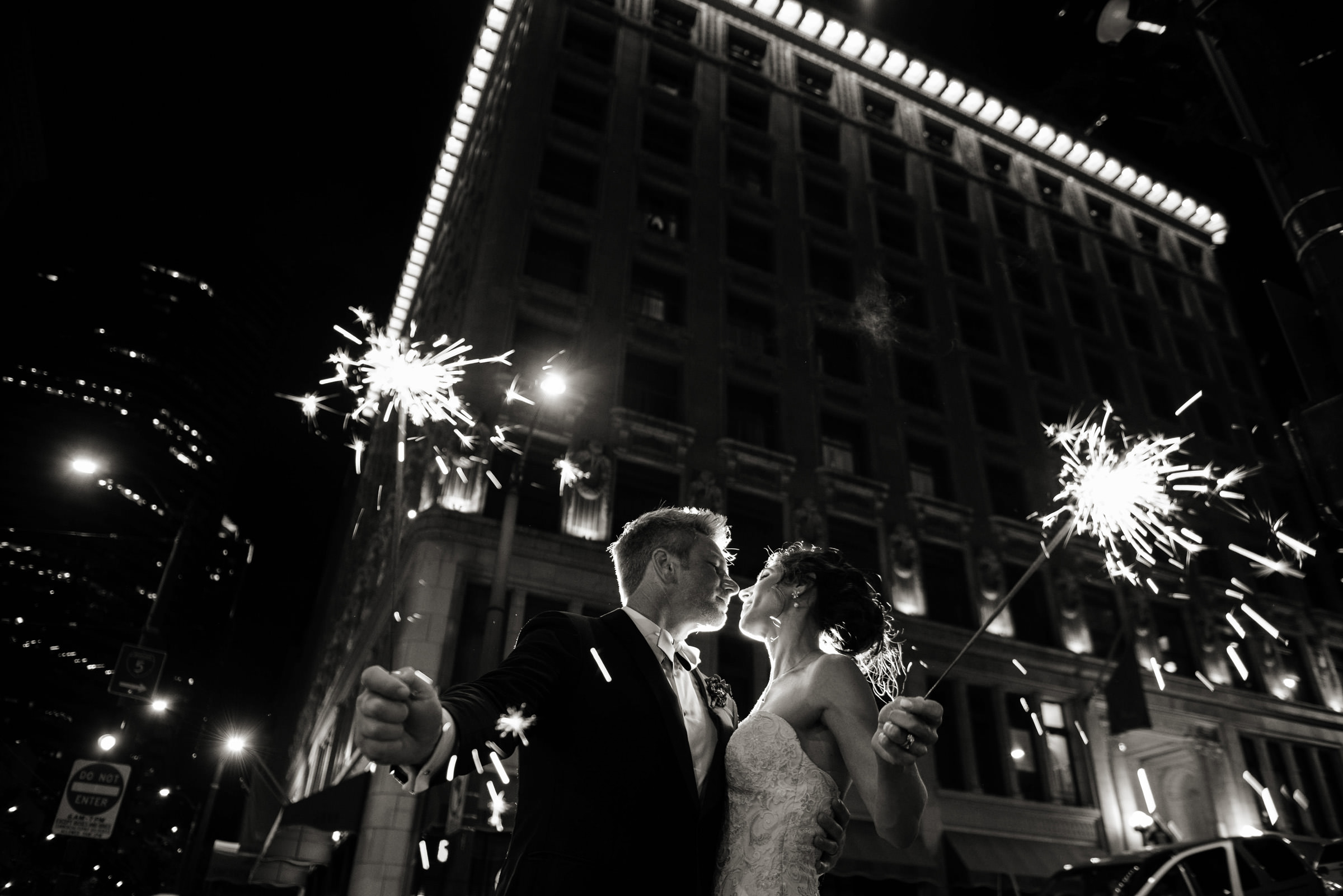 Couple with sparklers against city lights - photo by Barbie Hull Photography