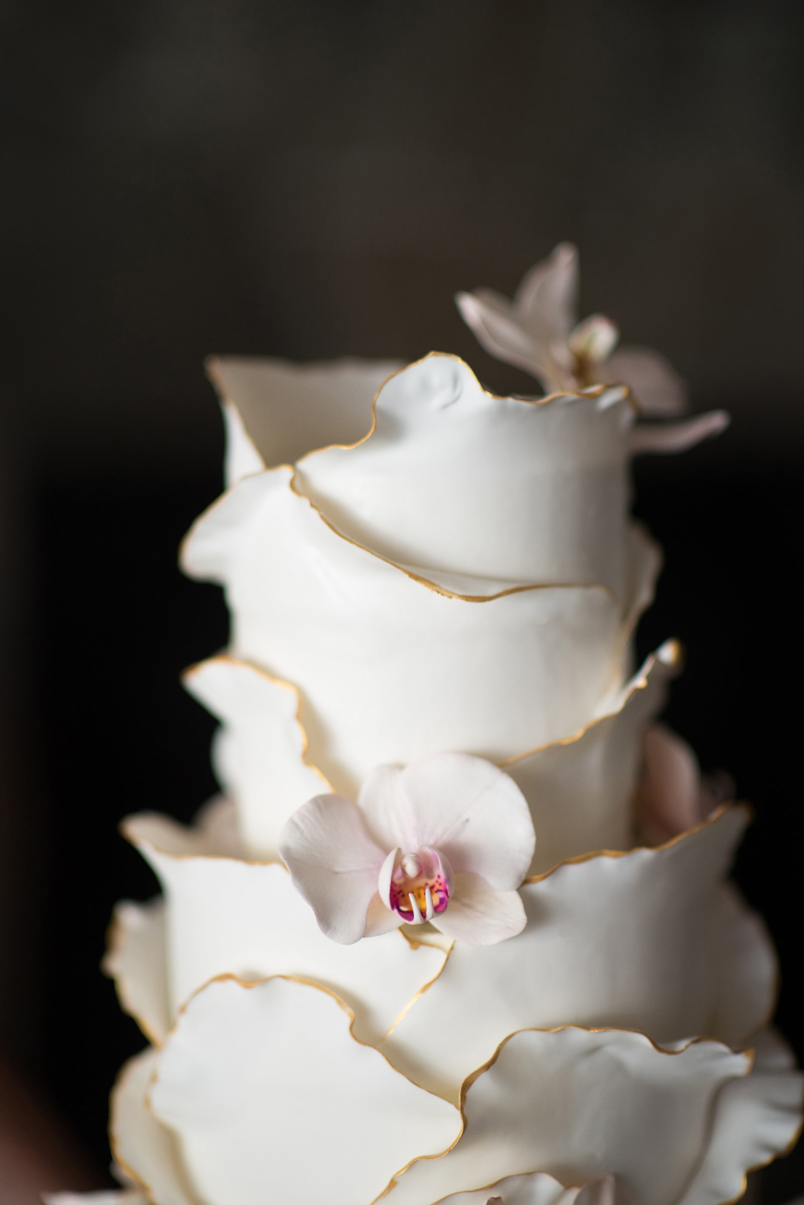 Magnificent ruffled cake with orchid decoration - photo by Barbie Hull Photography