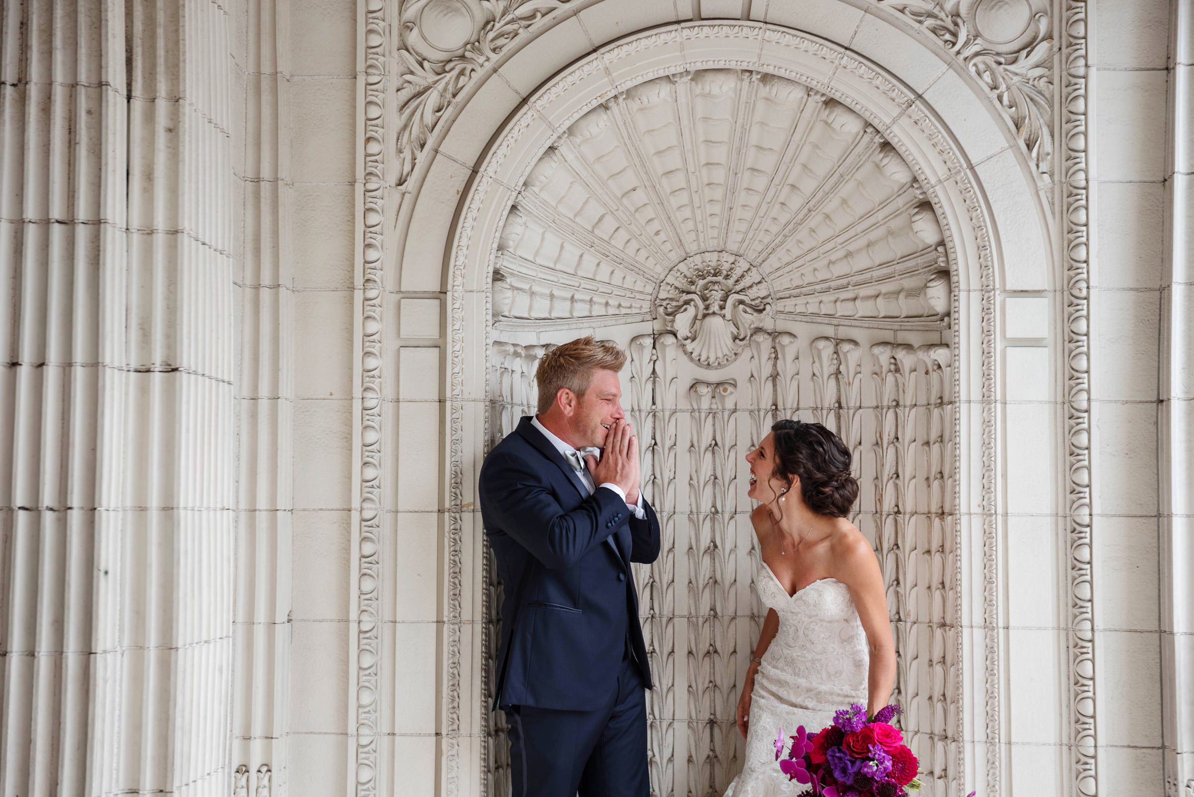 Moment of laughter in ornate alcove - photo by Barbie Hull Photography