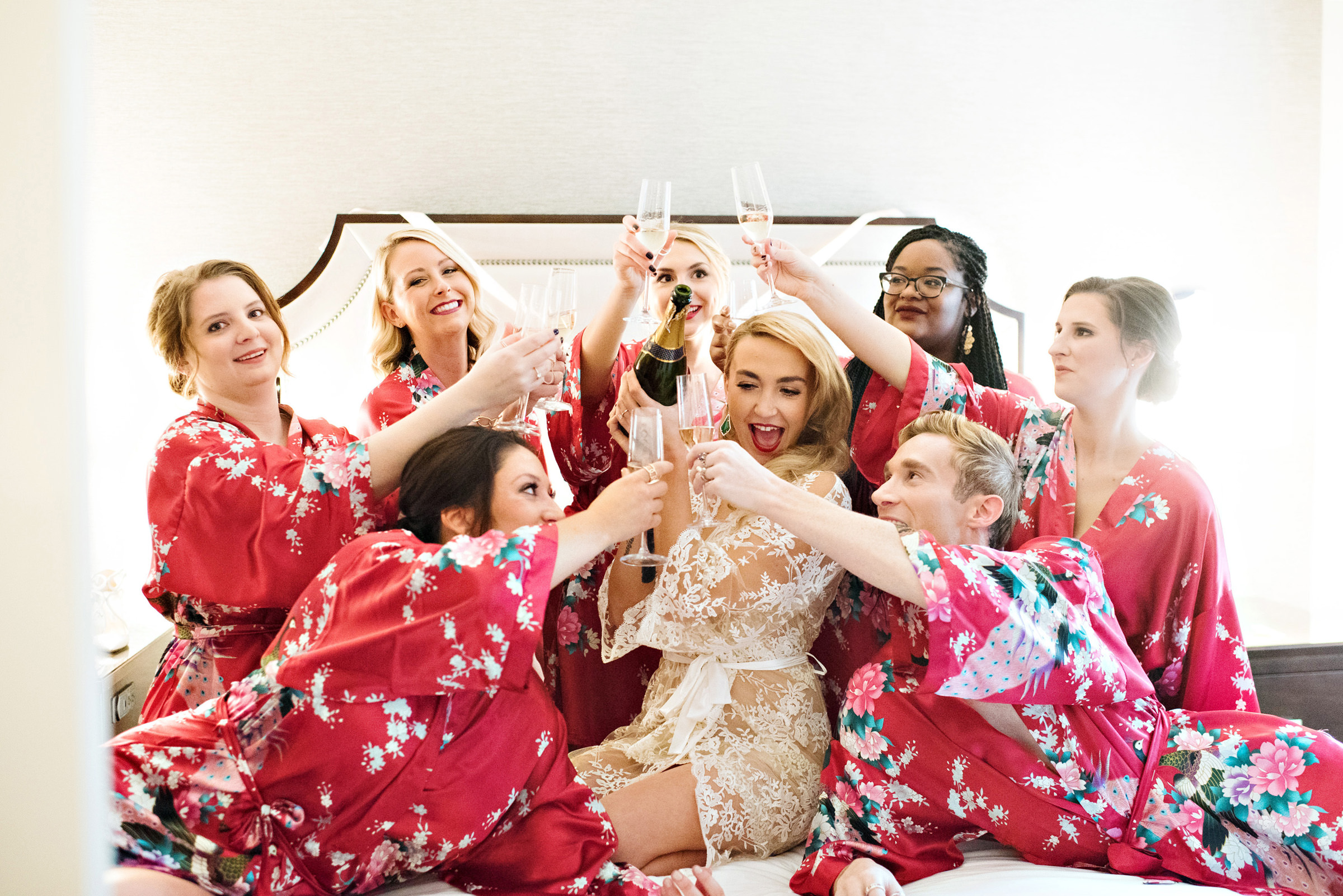 Passel of bridal party toasting bride - photo by Barbie Hull Photography